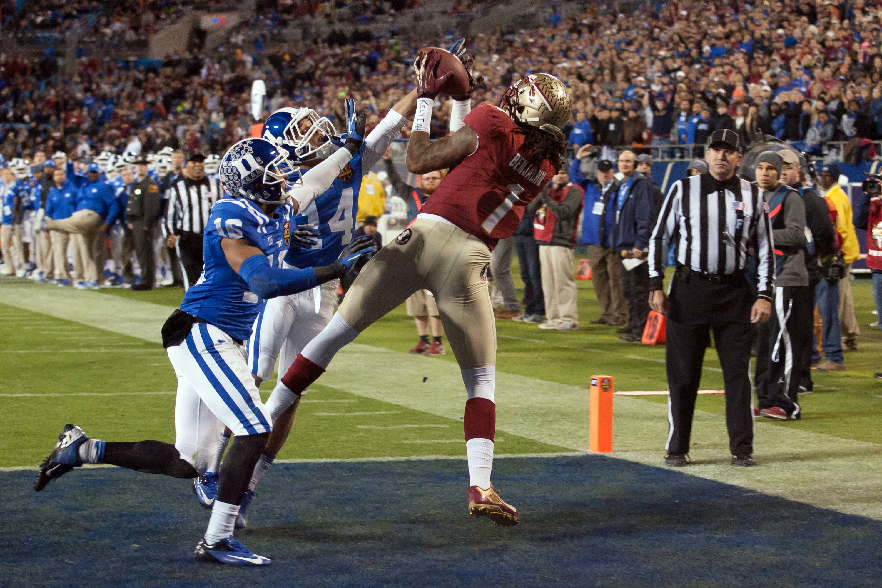 Dec 7, 2013; Charlotte, NC, USA; Florida State Seminoles wide receiver Kelvin Benjamin (1) catches a touchdown pass during the first quarter against the Duke Blue Devils at Bank of America Stadium. Mandatory Credit: Jeremy Brevard-USA TODAY Sports