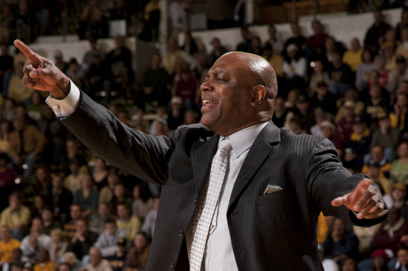 Florida State head coach Leonard Hamilton gets his teams attention while they are playing Georgia Tech.