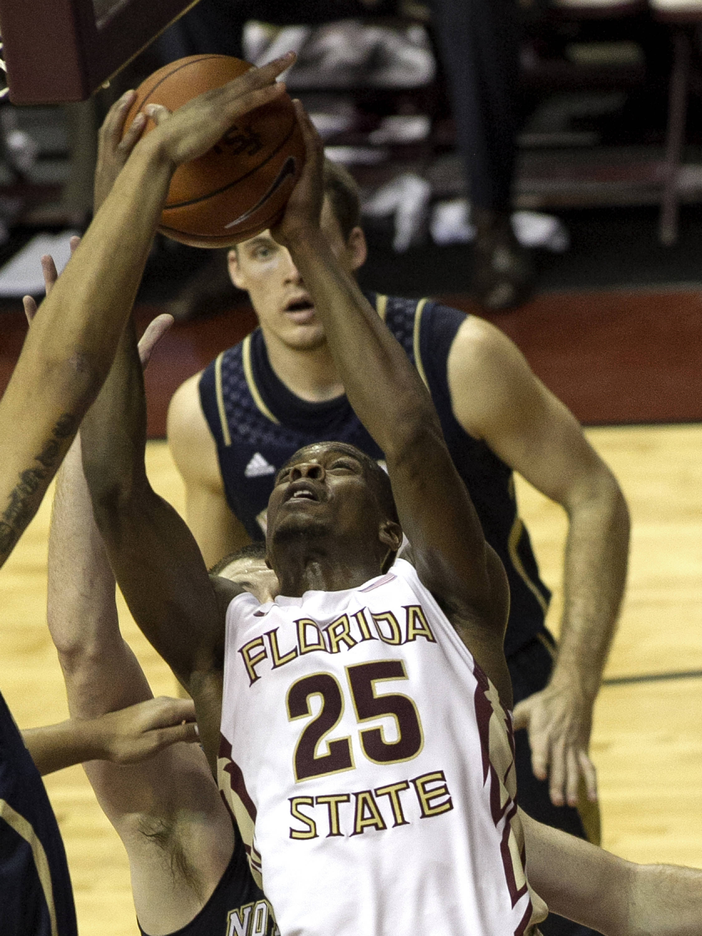 Aaron Thomas (25) battling under the basket, FSU vs Notre Dame, 1-21-14, (Photo's by Steve Musco)
