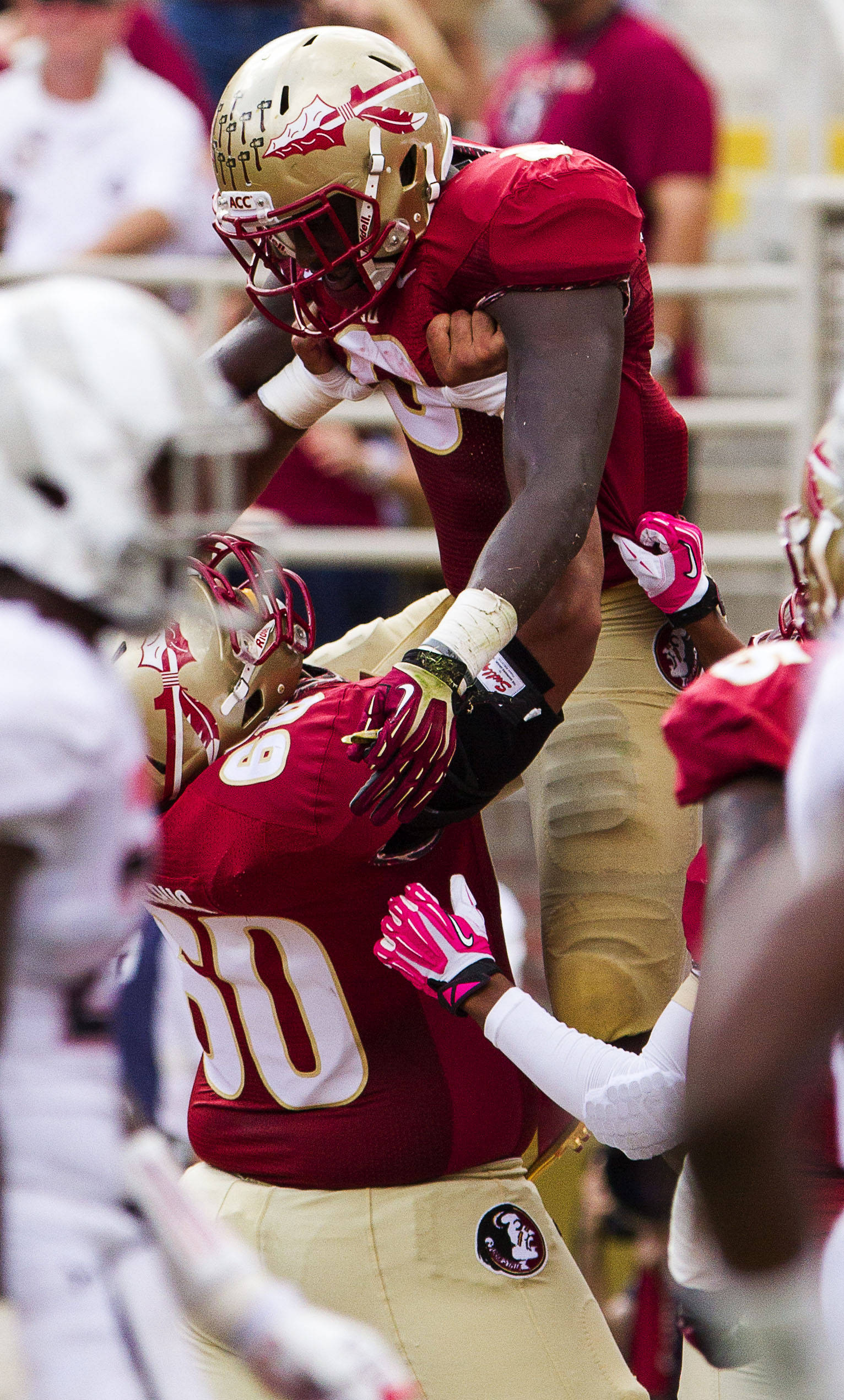 Karlos Williams (9) is lifted in the air after scoring a touchdown during FSU Football's 63-0 shutout of Maryland on Saturday, October 5, 2013 in Tallahassee, Fla.