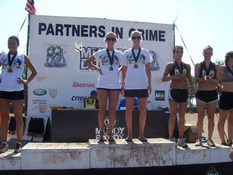 Erica (left) and Ella receive their gold medals after winning their age group at the 2009 Muddy Buddy competition at Walt Disney World in Orlando, Fla.