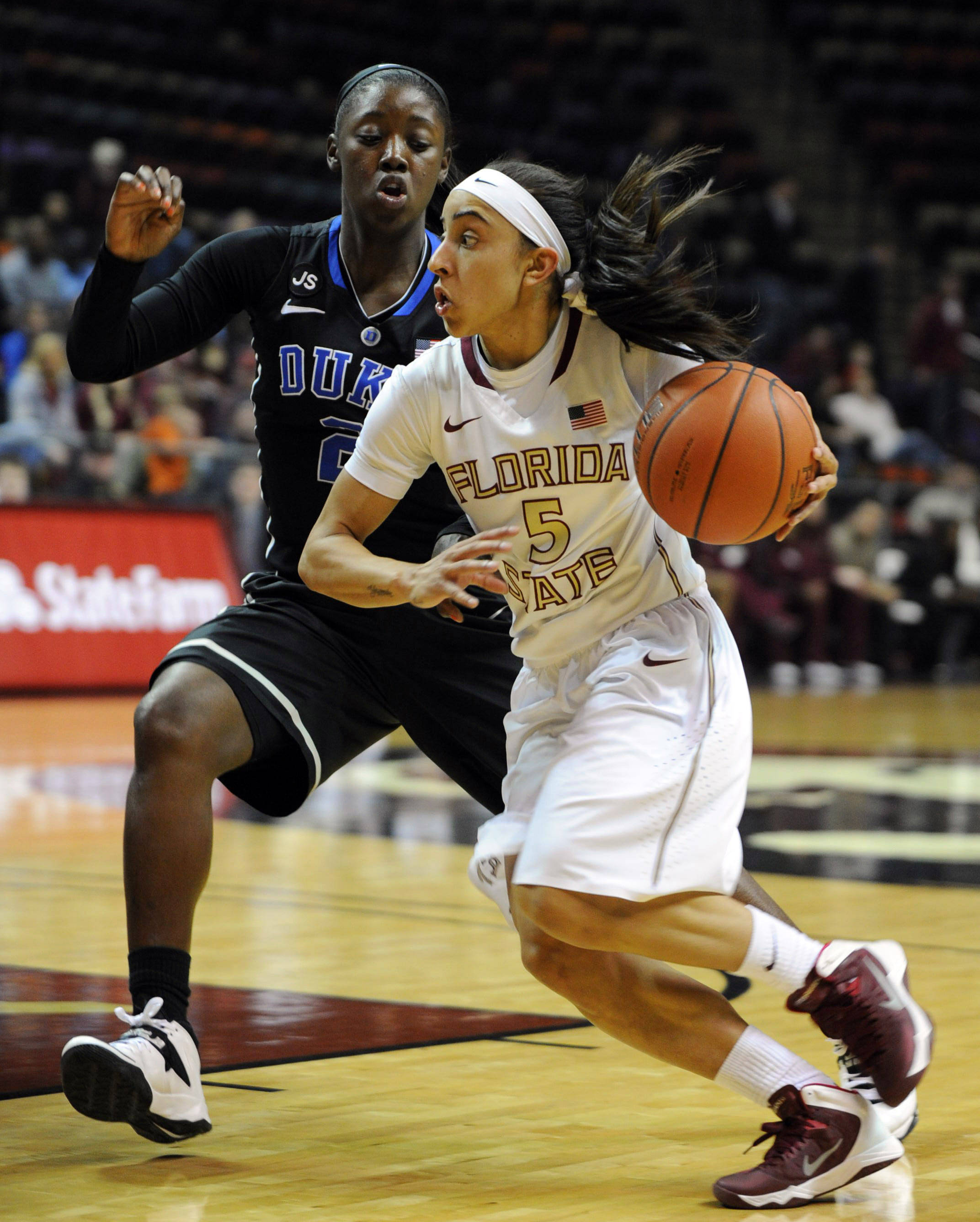 Jan 23, 2014; Tallahassee, FL, USA; Florida State Seminoles guard Cheetah Delgado (5) moves the ball past Duke Blue Devils guard Alexis Jones (2) during the first half of the game at the Donald L. Tucker Center (Tallahassee). Mandatory Credit: Melina Vastola-USA TODAY Sports