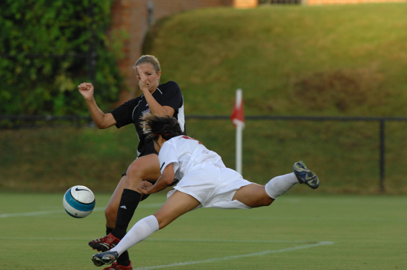 Mami Yamaguchi diving header finds the back of the net for one of her three goals.