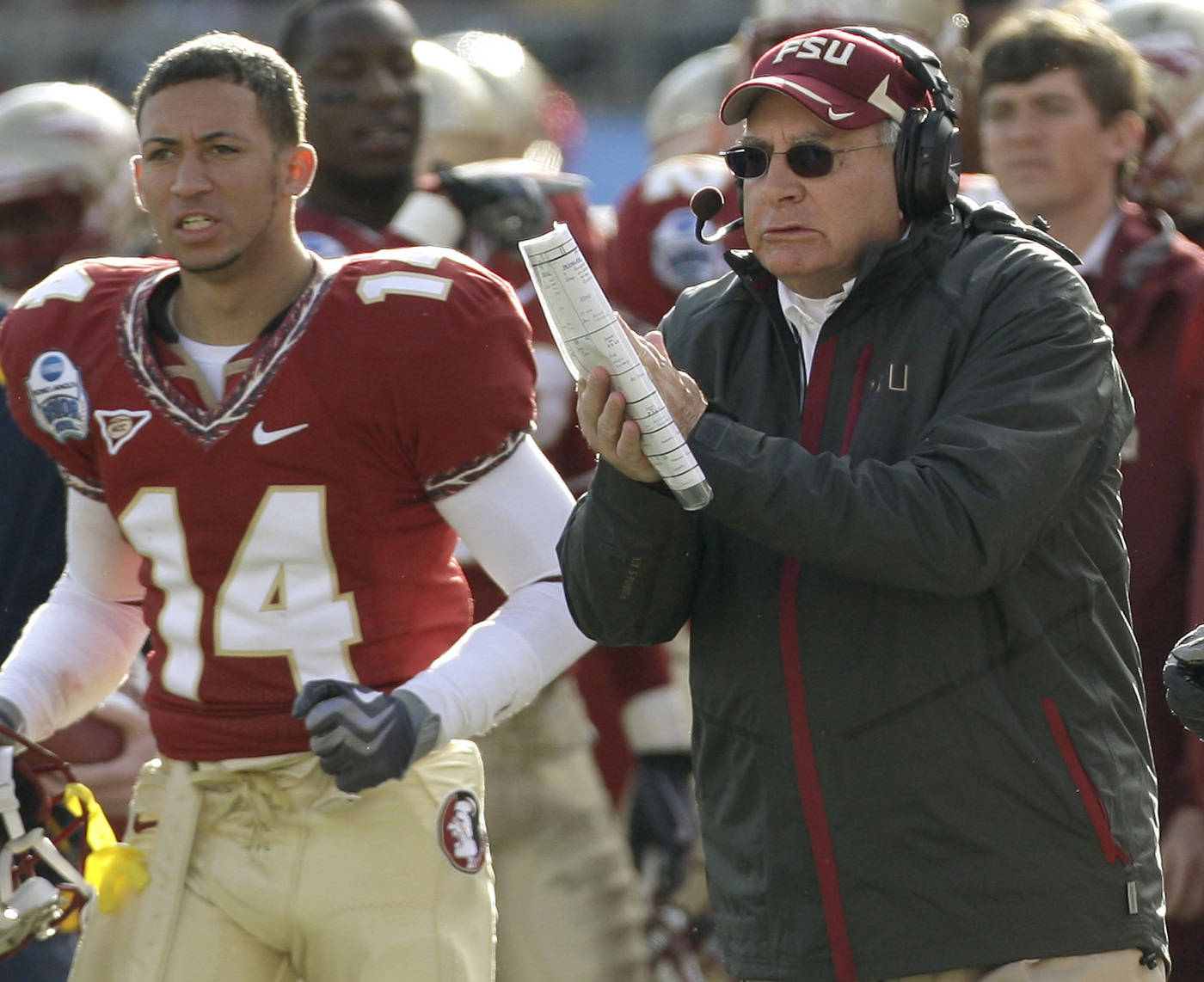 Florida State defensive coordinator Mickey Andrews, right, applauds his defense during the third quarter of the Gator Bowl NCAA college football game against West Virginia, Friday, Jan. 1, 2010, in Jacksonville, Fla.  Florida State won 33-21.(AP Photo/Phil Coale)