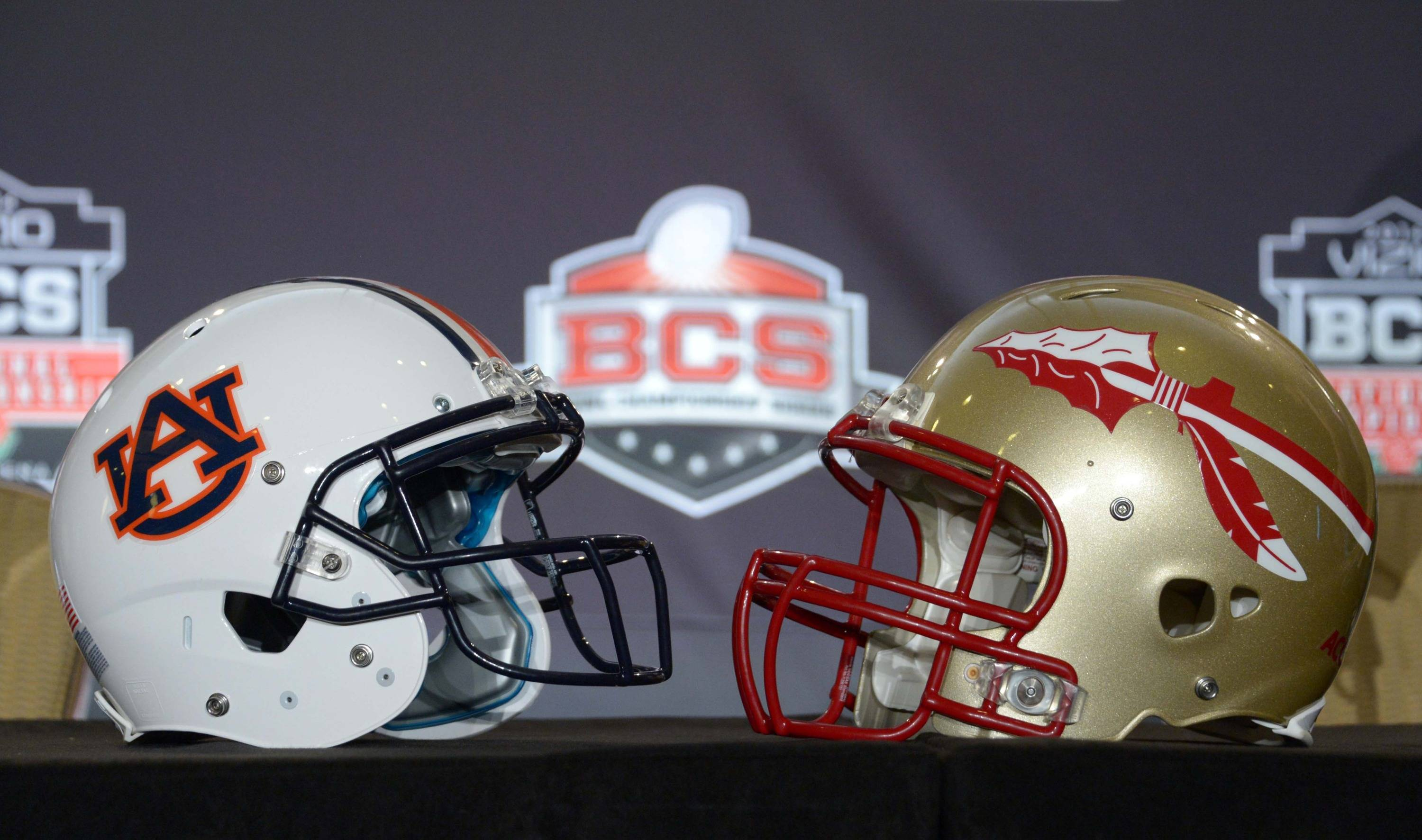 General view of the Florida State Seminoles (right) and Auburn Tigers helmets at the 2014 BCS National Championship press conference at Newport Beach Marriott. Mandatory Credit: Kirby Lee-USA TODAY Sports