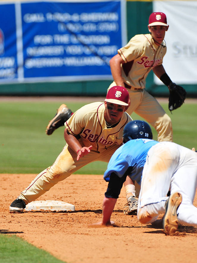 Devon Travis follows suit, slapping the tag on another ill-fated UNC baserunner.