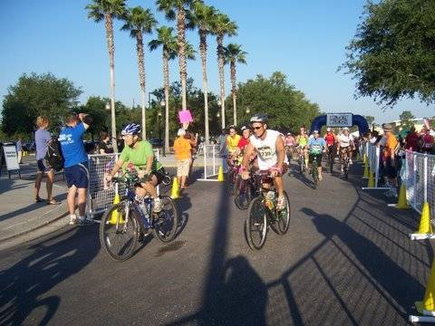 Ella competes in the bicycle portion of the event
