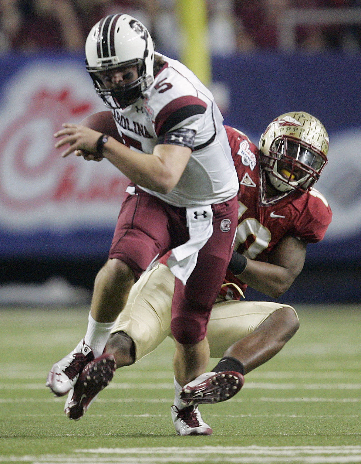 South Carolina quarterback Stephen Garcia (5) is stopped by Florida State safety Nick Moody (10) in the second quarter of the Chick-fil-A Bowl NCAA college football game on Friday, Dec. 31, 2010, in Atlanta. (AP Photo/John Amis)