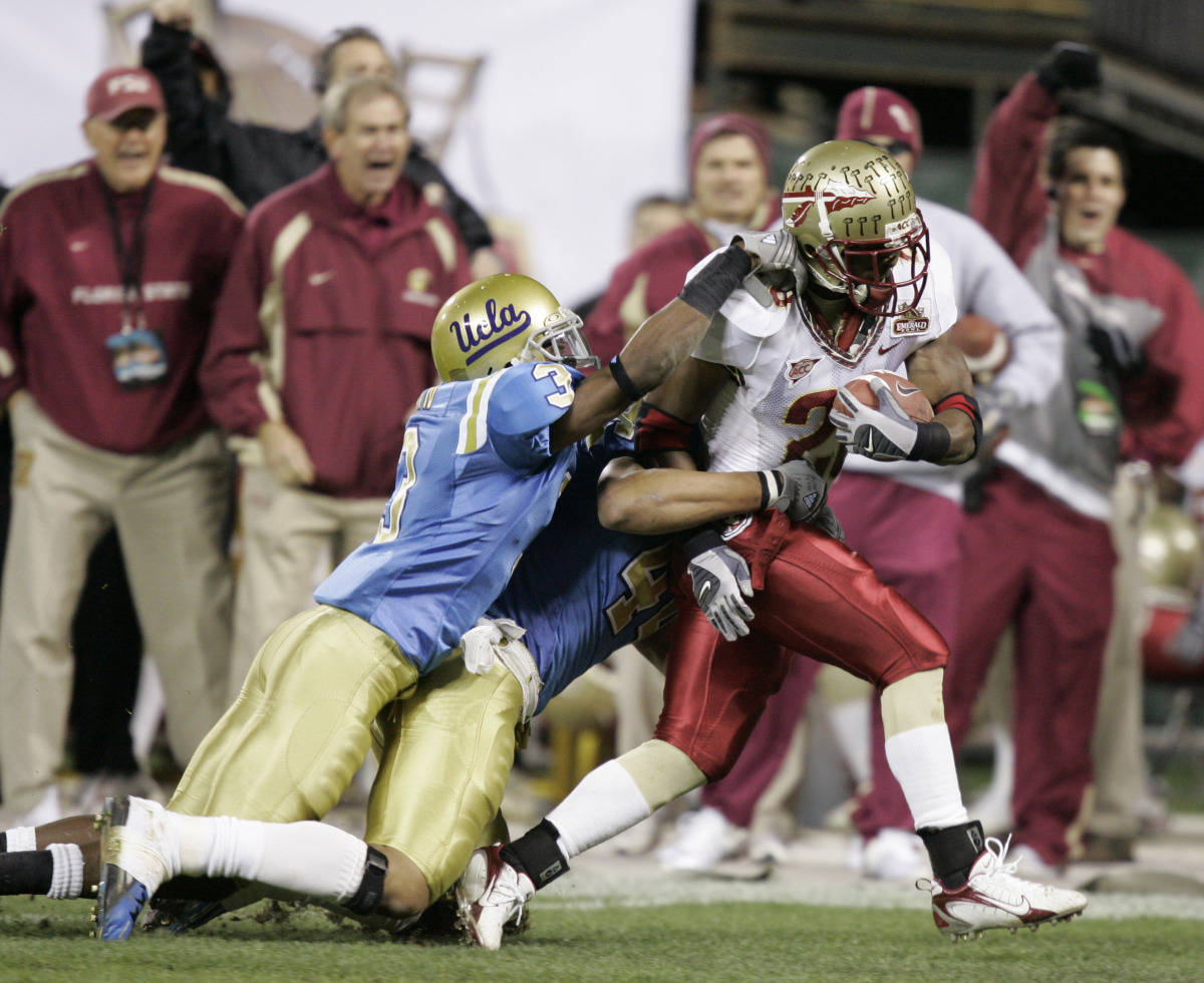 Florida State running back Lorenzo Booker, right, runs for a 25-yard touchdown while UCLA linebacker Steven Miller, center, and cornerback Rodney Van try to bring him down during the first half of the Emerald Bowl college football game in San Francisco, Wednesday, Dec. 27, 2006.(AP Photo/Marcio Jose Sanchez)