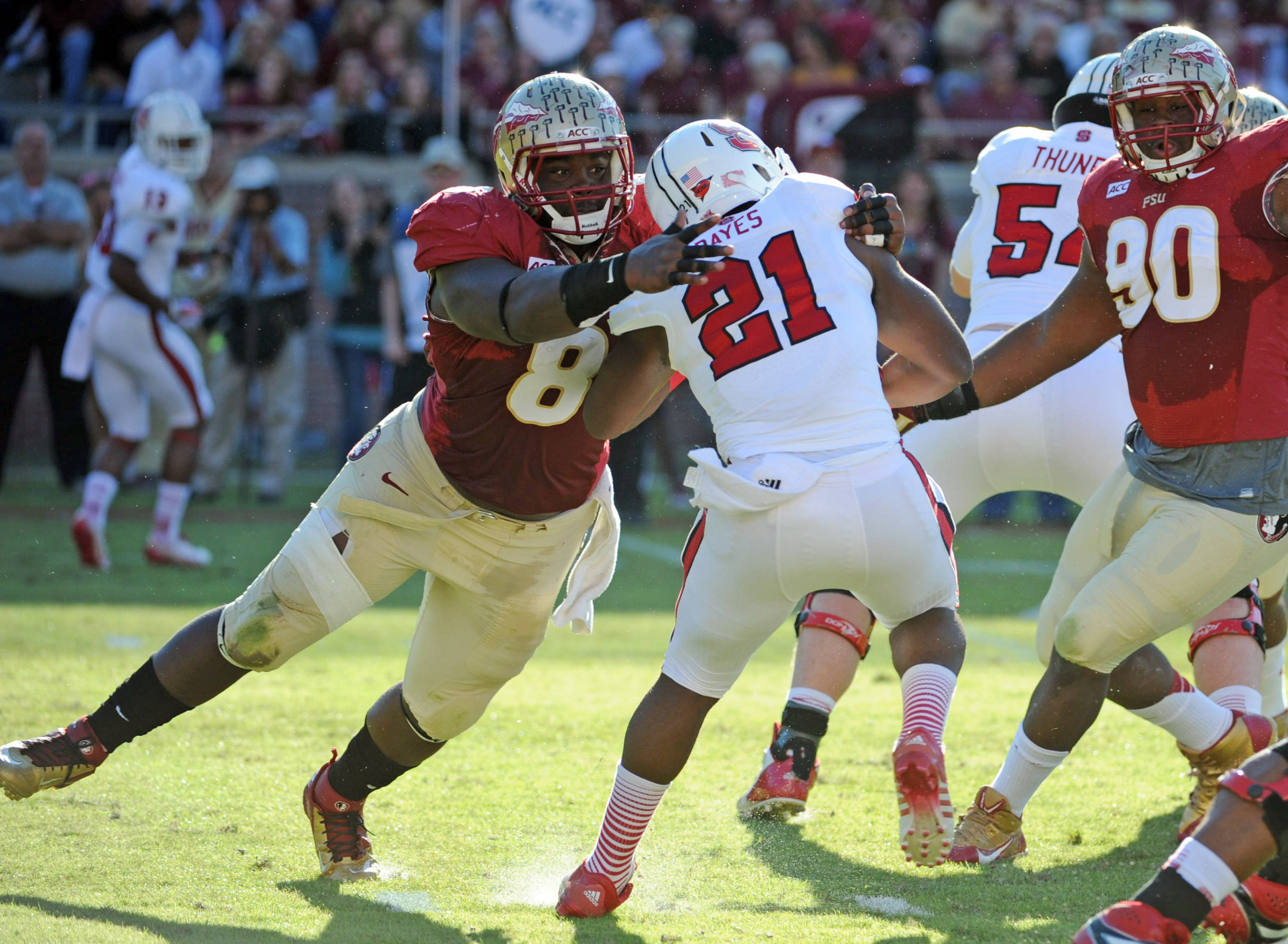 Timmy Jernigan (8) tackles North Carolina State Wolfpack running back Matt Dayes (21). Mandatory Credit: Melina Vastola-USA TODAY Sports