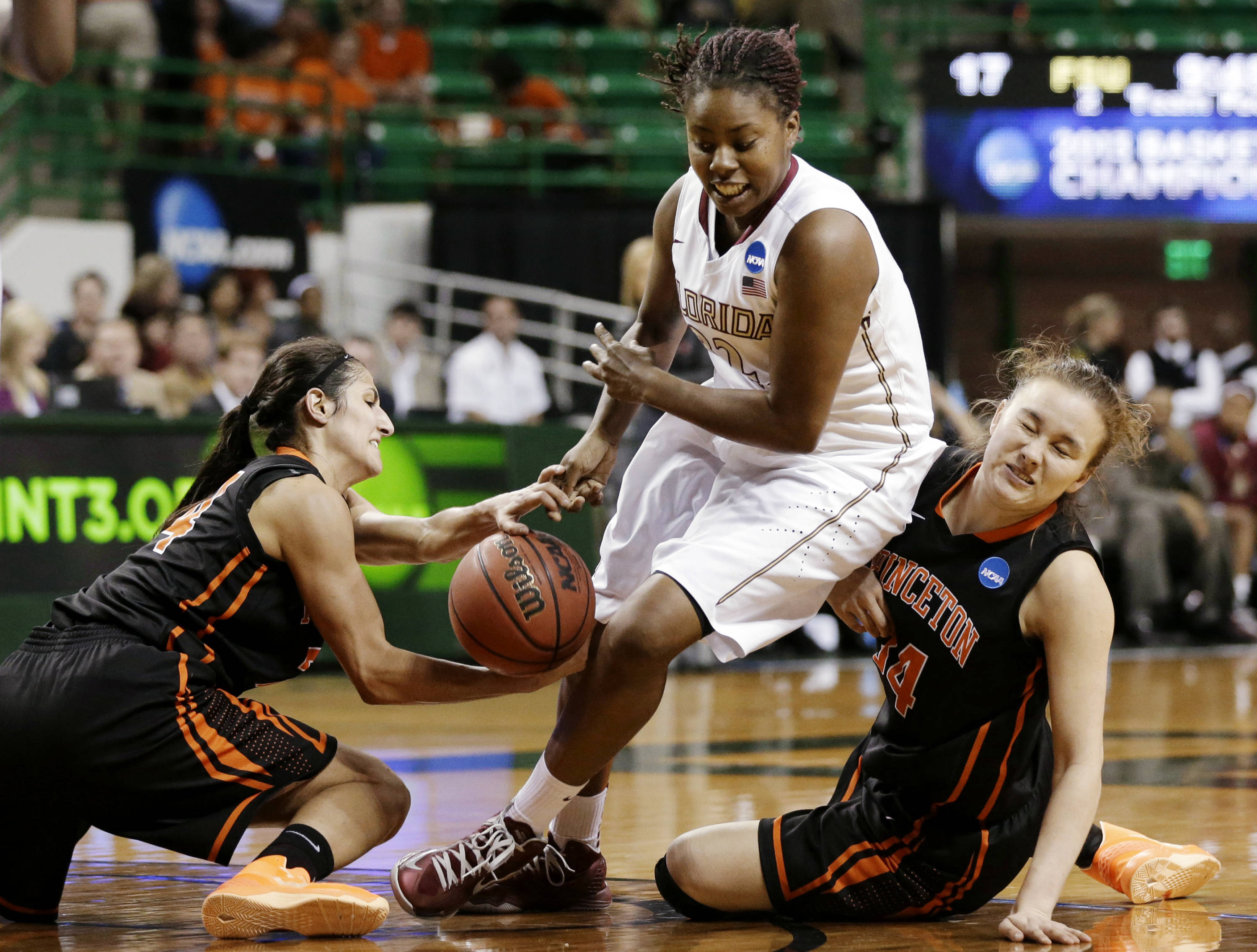 Princeton guard Niveen Rasheed, left, and Michelle Miller, right, combine to steal a ball away from Florida State's Lauren Coleman, center, in the first half of a first-round game in the women's NCAA college basketball tournament, Sunday, March 24, 2013, in Waco, Texas. (AP Photo/Tony Gutierrez)