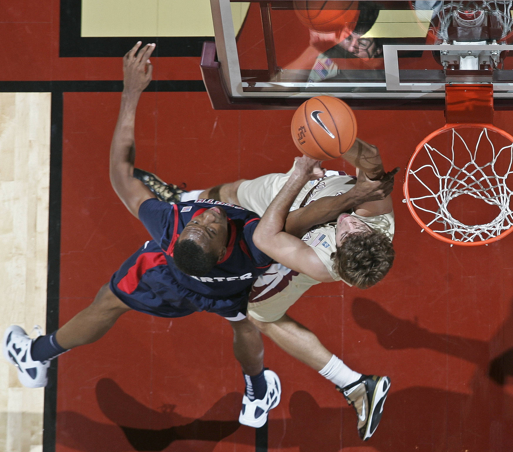 Florida State guard Luke Loucks, right, draws contact from South Alabama forward Javier Carter.. (AP Photo/Phil Sears)