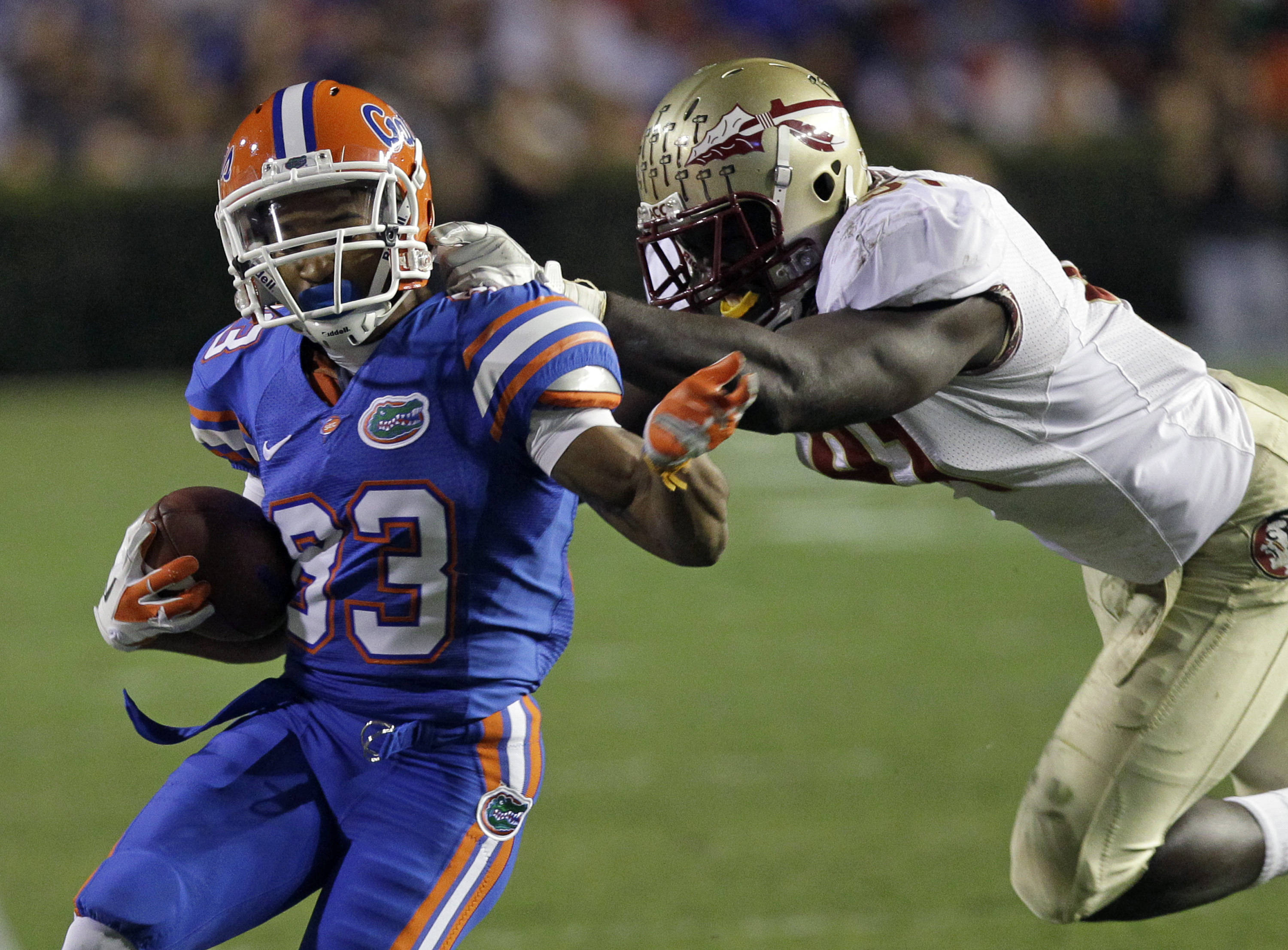 Florida wide receiver Solomon Patton (83) is tackled by Florida State defensive end Cornellius Carradine, right,  after a reception during the first half of an NCAA college football game on Saturday, Nov. 26, 2011, in Gainesville, Fla. (AP Photo/John Raoux)