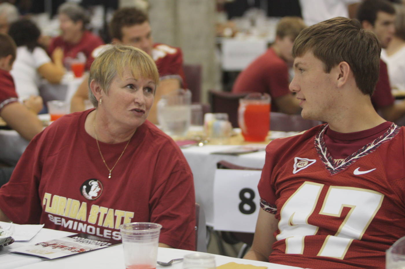 Jonathan Wallace sits next to a fan at the 2009 Football Luncheon.