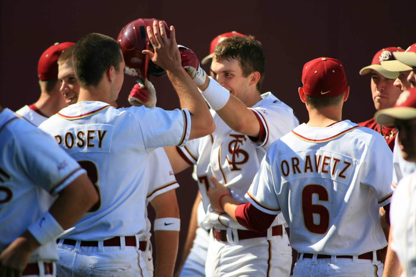 The Seminoles celebrate following Parker Brunelle's home run in game one