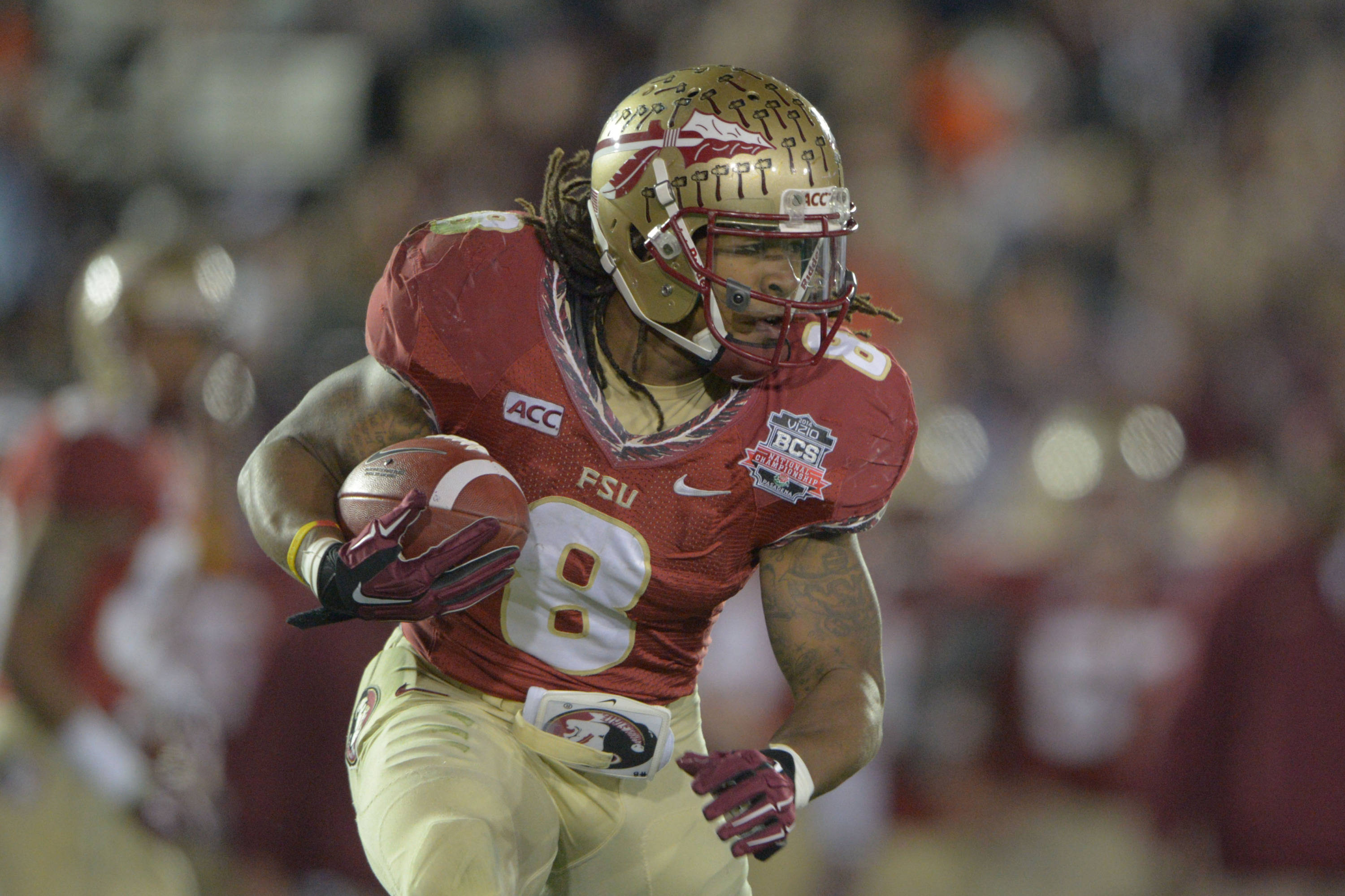Jan 6, 2014; Pasadena, CA, USA; Florida State Seminoles running back Devonta Freeman (8) runs the football against the Auburn Tigers during the first half of the 2014 BCS National Championship game at the Rose Bowl.  Mandatory Credit: Kirby Lee-USA TODAY Sports