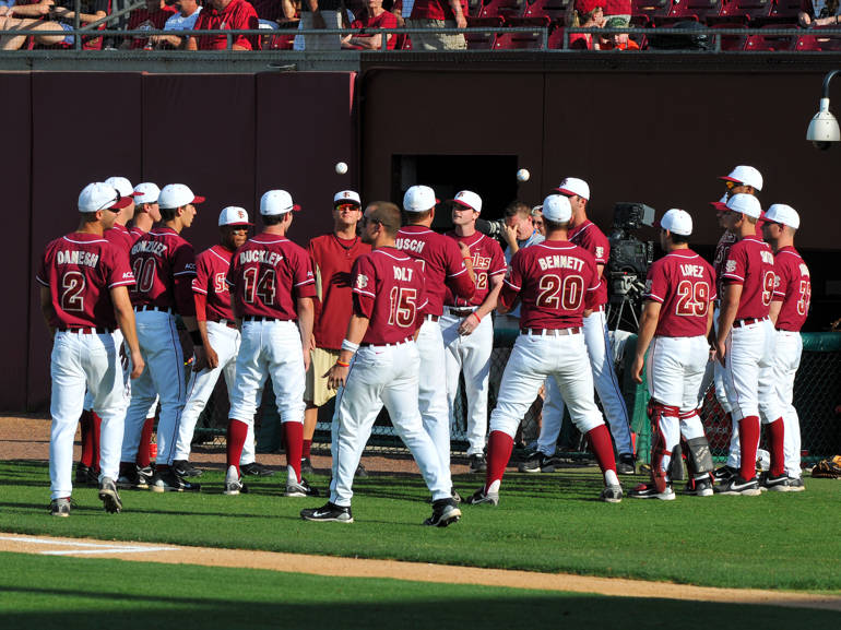 The Seminoles participate in a pregame toss around before the start of Tuesday night's game against Florida.