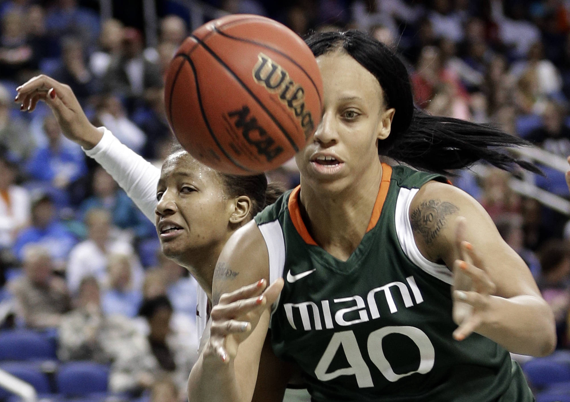 Miami's Shawnice Wilson, right, battles with Florida State's Chelsea Davis, left, for a rebound. (AP Photo/Chuck Burton)