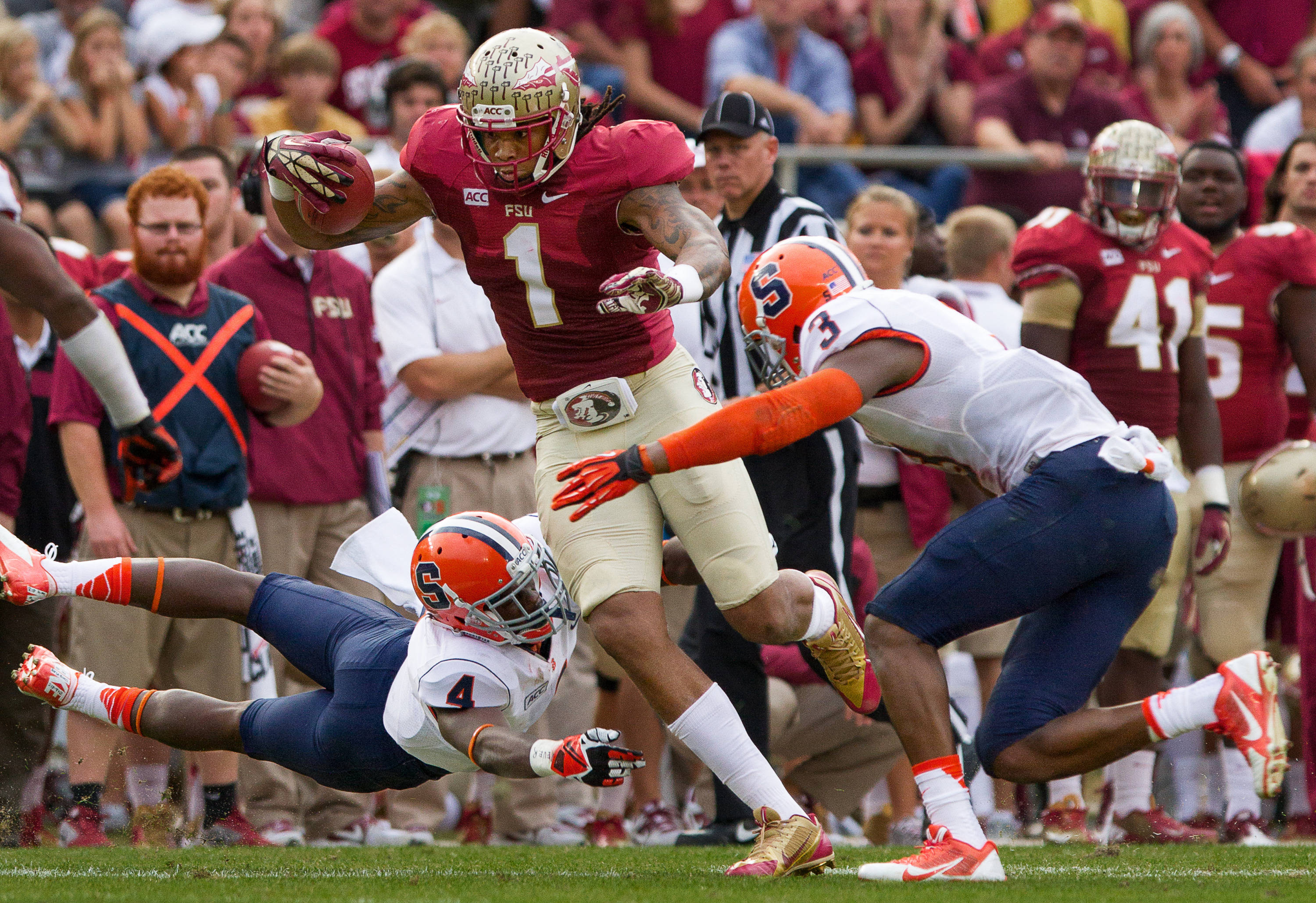 Kelvin Benjamin (1) carries the ball during FSU Football's 59-3 win over Syracuse on Saturday, November 16, 2013 in Tallahassee, Fla. Photo by Mike Schwarz.