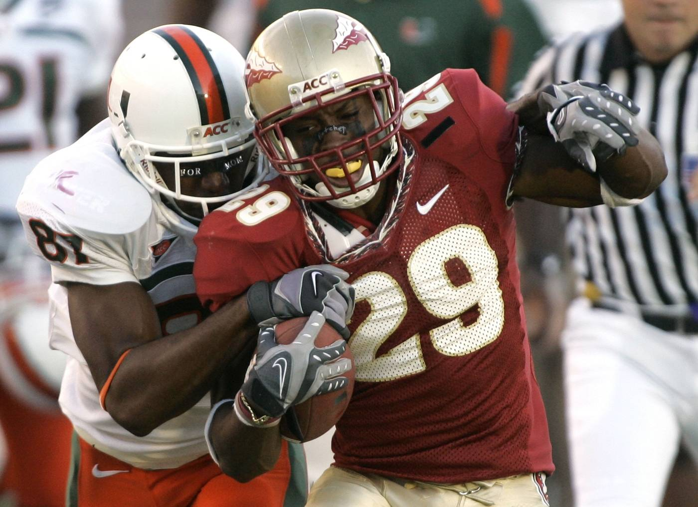 Florida State's Michael Ray Garvin, left, is tackled by Miami's Khalil Jones on a third quarter kickoff return. (AP Photo/Phil Coale)