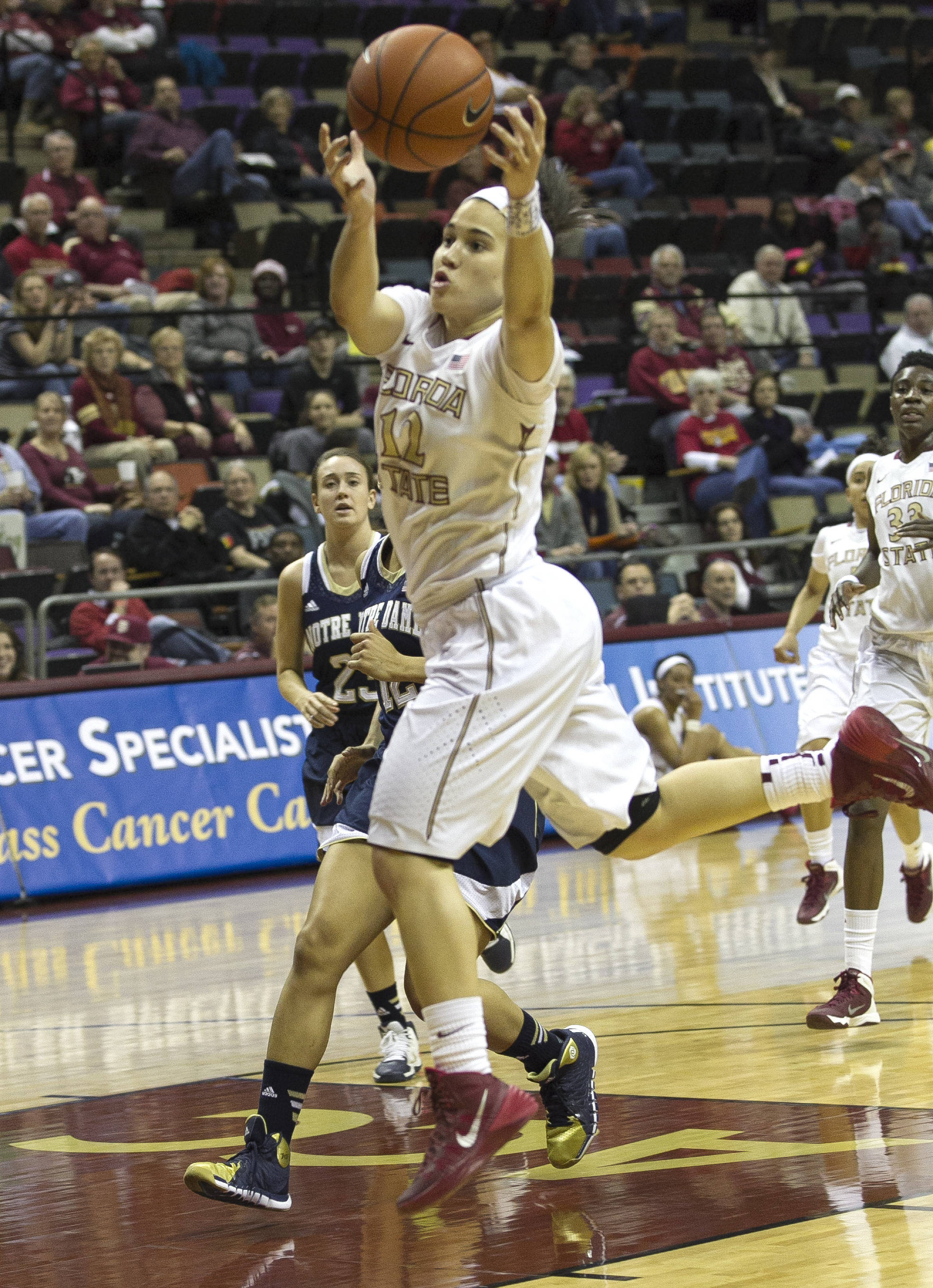 Brittany Brown (12) reaches high to keep a ball inbounds, FSU vs Notre Dame, 2-06-14, (Photo's by Steve Musco)