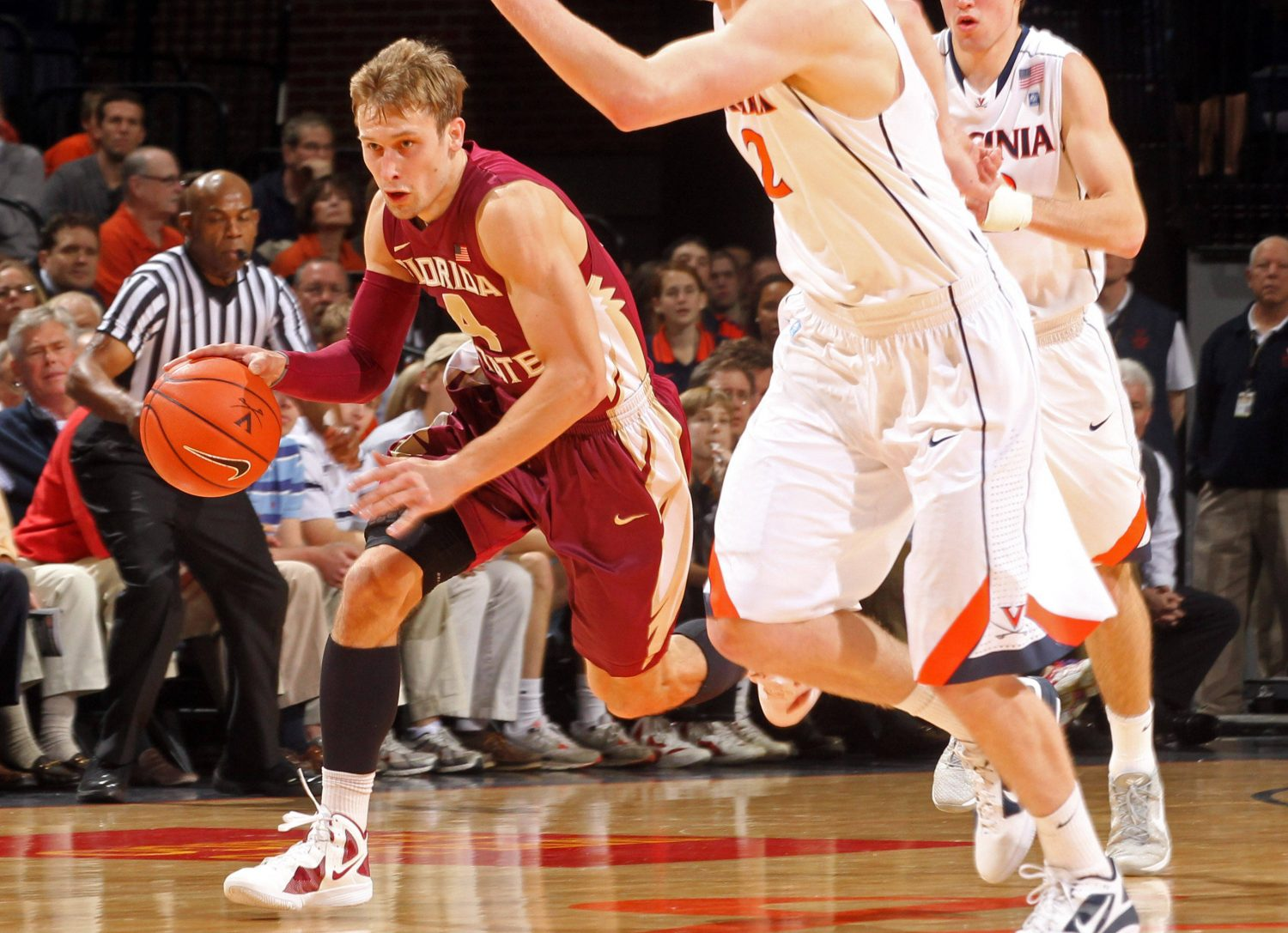 Florida State guard Deividas Dulkys drives past Virginia defenders after stealing the ball during the first half. (AP Photo/Andrew Shurtleff)