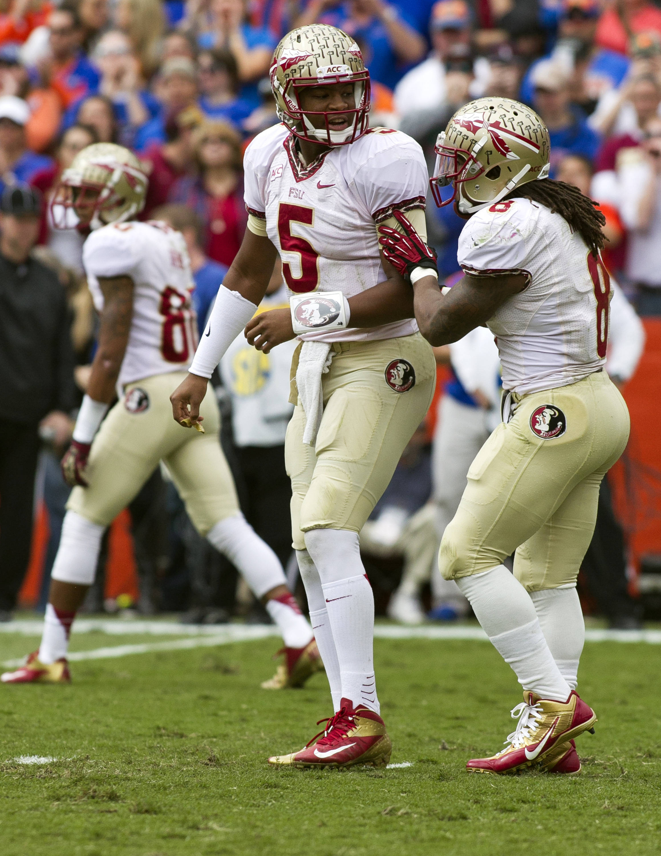Jameis Winston (5) and Devonta Freeman getting their signals straight. FSU vs Florida, 11-30-13,  (Photo by Steve Musco)