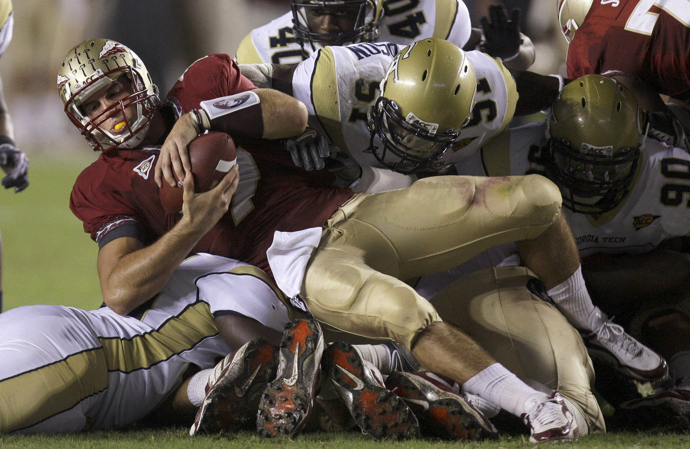 Florida State quarterback Christian Ponder, center, falls for first-down yardage as Georgia Tech linebacker Brad Jefferson, (51) tries to make the stop during an NCAA college football game, Saturday, Oct. 10, 2009, in Tallahassee, Fla.