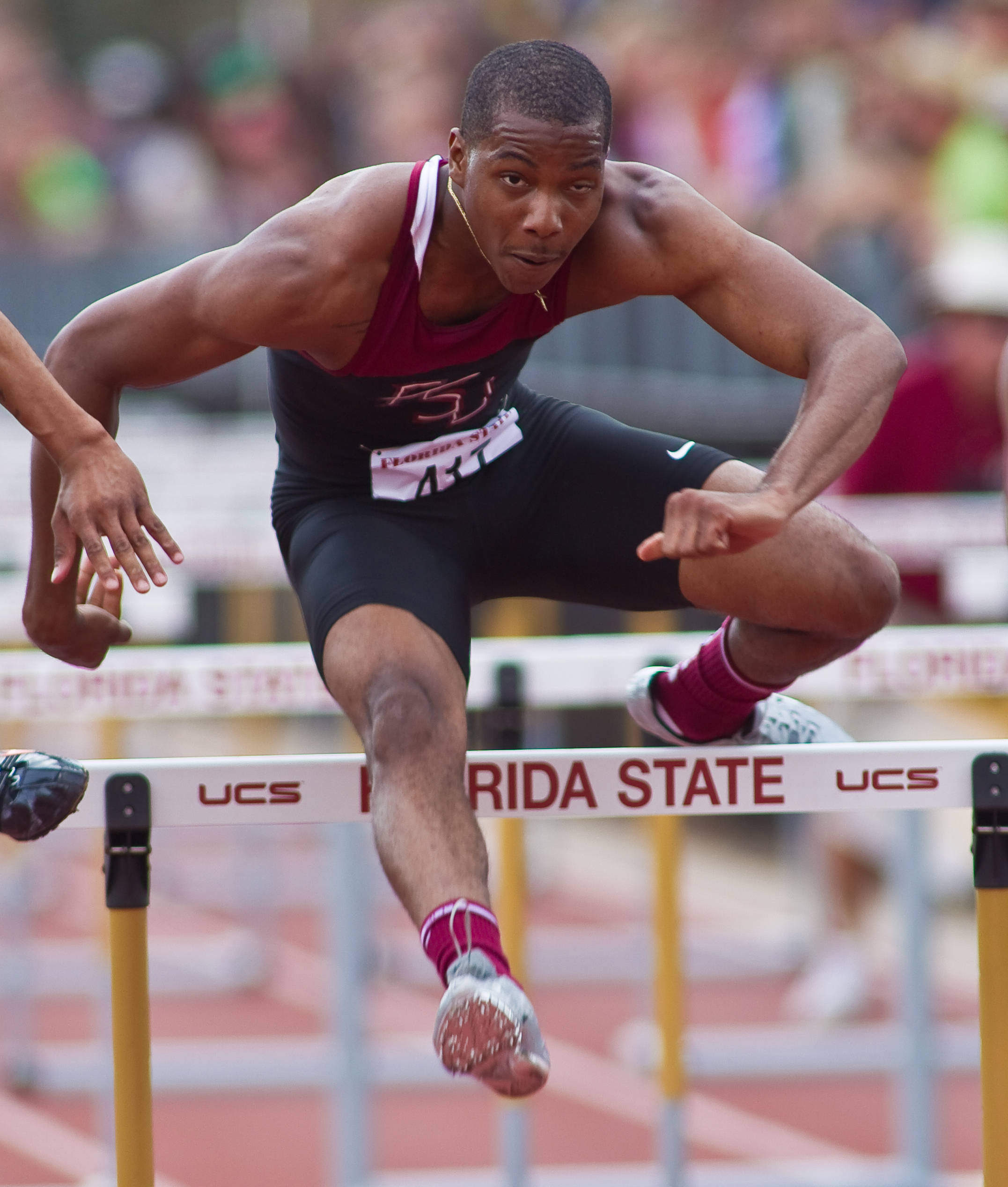 Justin Byrd drives over the top in the 110-meter high hurdles for the Seminoles.