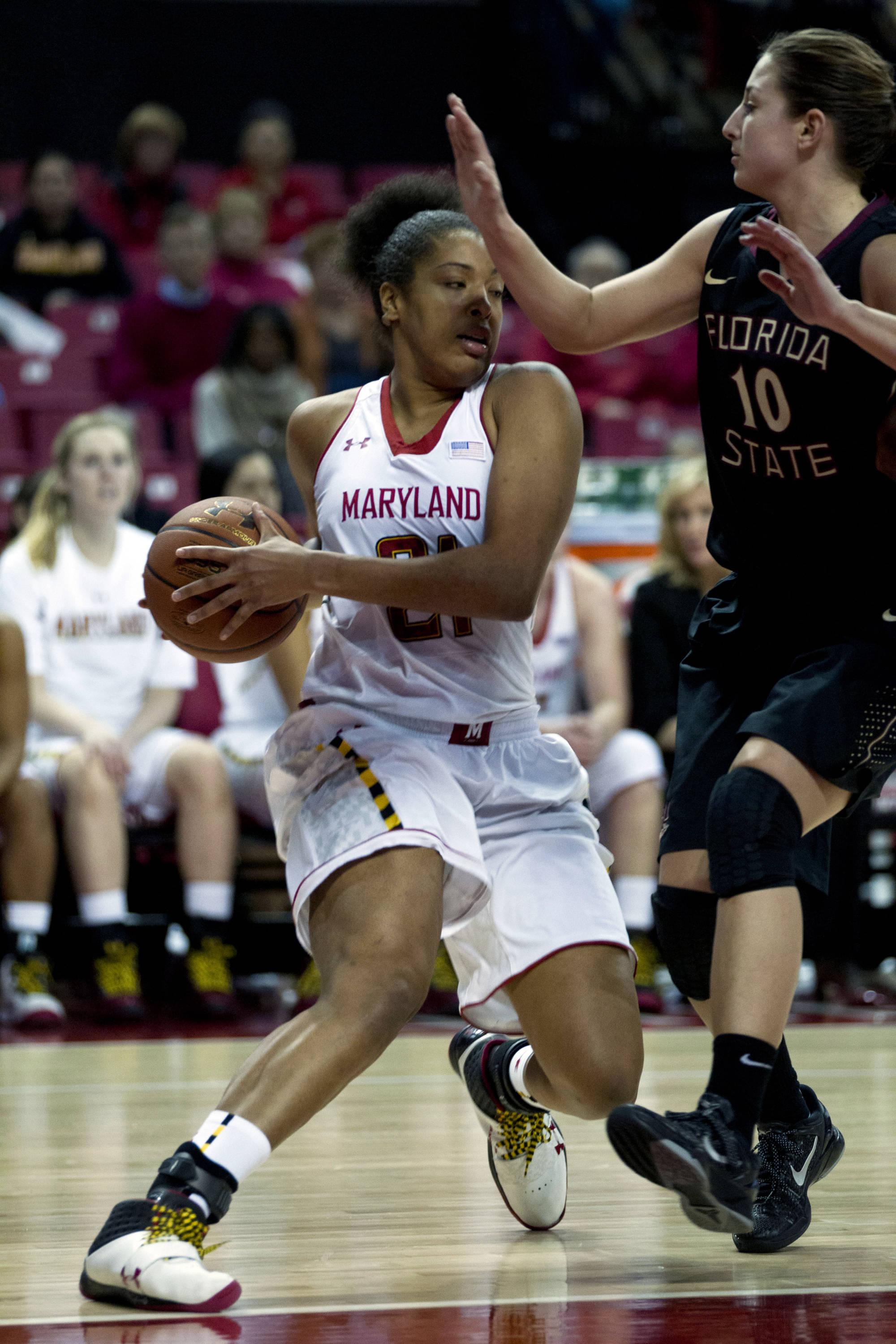 Maryland's Tianna Hawkins (21) moves the ball against Florida State's Leonor Rodriguez during the second half. (AP Photo/Jose Luis Magana)