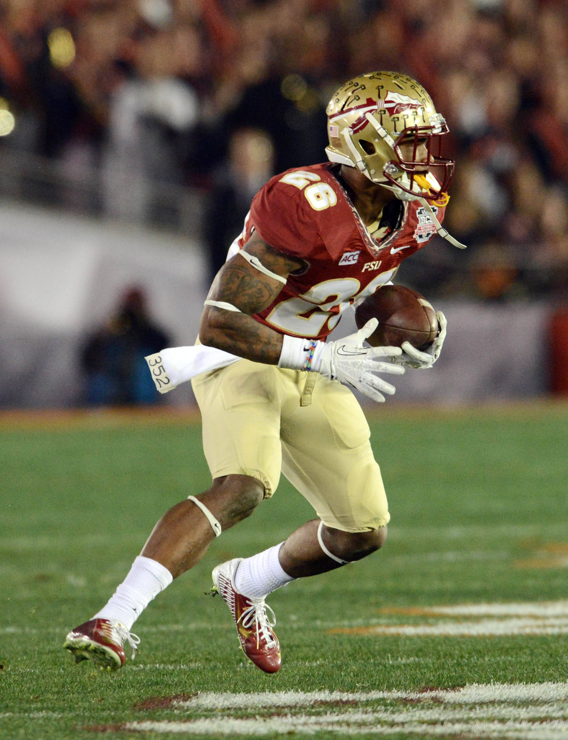 Jan 6, 2014; Pasadena, CA, USA; Florida State Seminoles defensive back P.J. Williams (26) intercepts a pass against the Auburn Tigers during the second half of the 2014 BCS National Championship game at the Rose Bowl.  Mandatory Credit: Jayne Kamin-Oncea-USA TODAY Sports