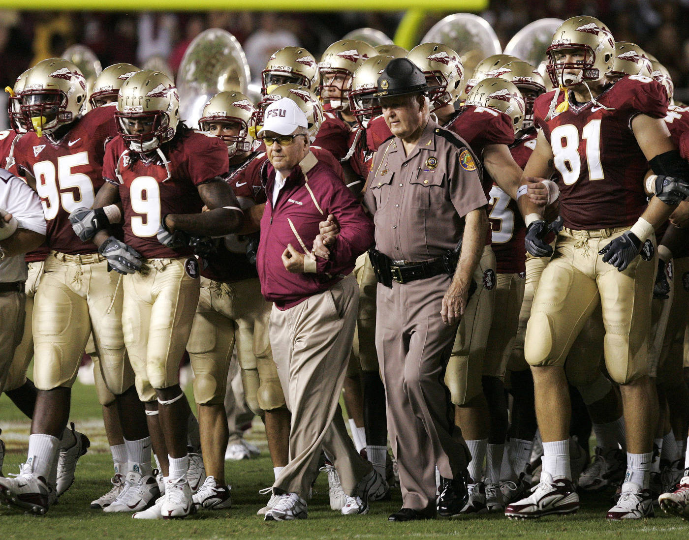 Florida State head coach Bobby Bowden, center, walks out with the team prior to the start of a NCAA football game against Georgia Tech on Saturday, Oct. 10, 2009, in Tallahassee, Fla.