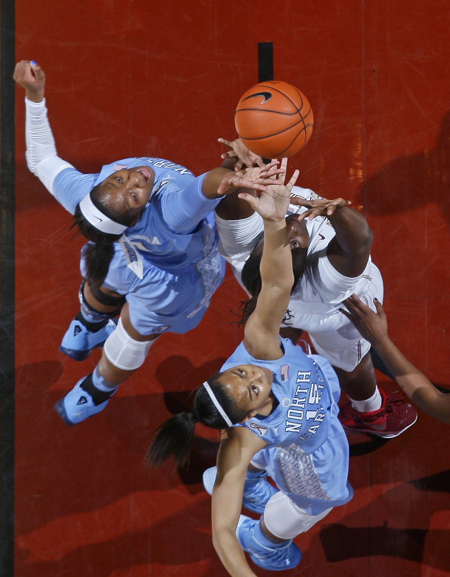 Jan 12, 2014; Tallahassee, FL, USA; North Carolina Tar Heels forward Stephanie Mavunga (1) and guard Allisha Gray (15) battle Florida State Seminoles forward Kai James (0) for a rebound in the first half at the Tucker Center. Mandatory Credit: Phil Sears-USA TODAY Sports