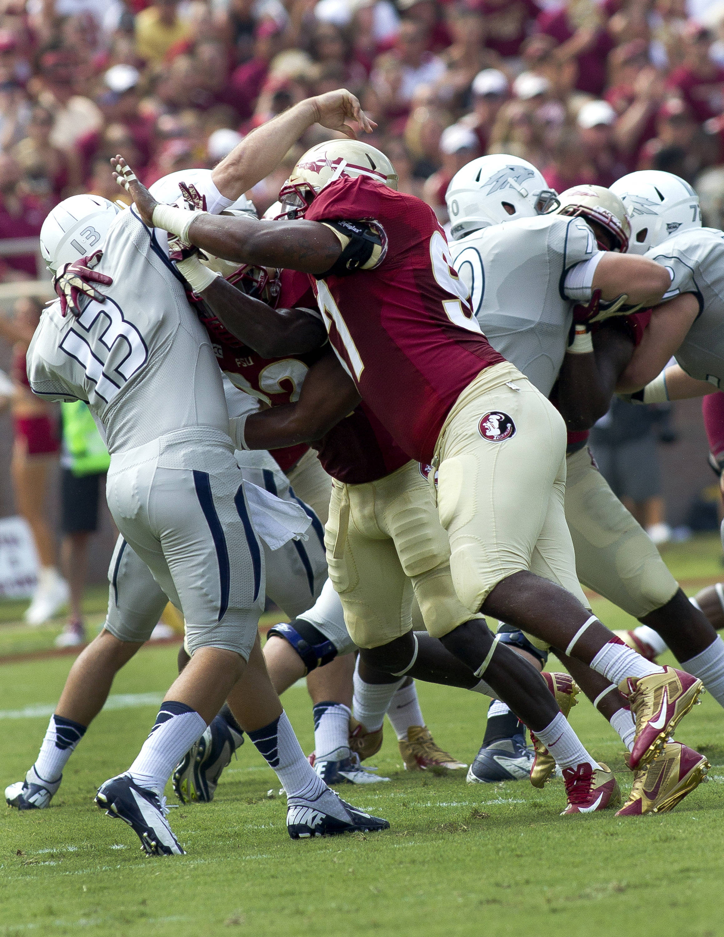 Demonte McAllister (97), FSU vs Nevada,  9-14-13, (Photo by Steve Musco)