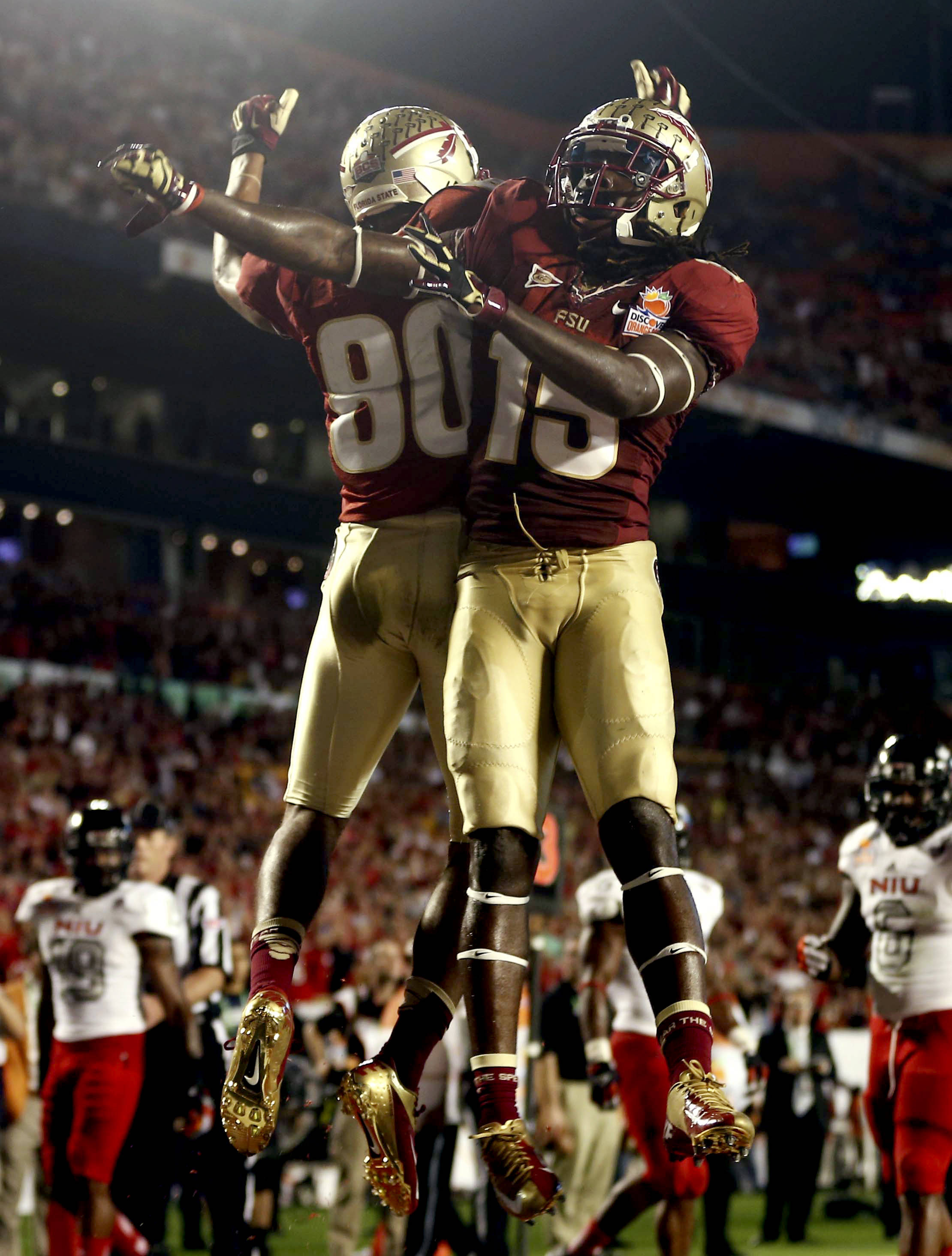 Florida State wide receivers Greg Dent (15) and Rashad Greene (80) celebrate after Greene scored a touchdown during the first half of the Orange Bowl NCAA college football game against Northern Illinois, Tuesday, Jan. 1, 2013, in Miami. (AP Photo/J Pat Carter)