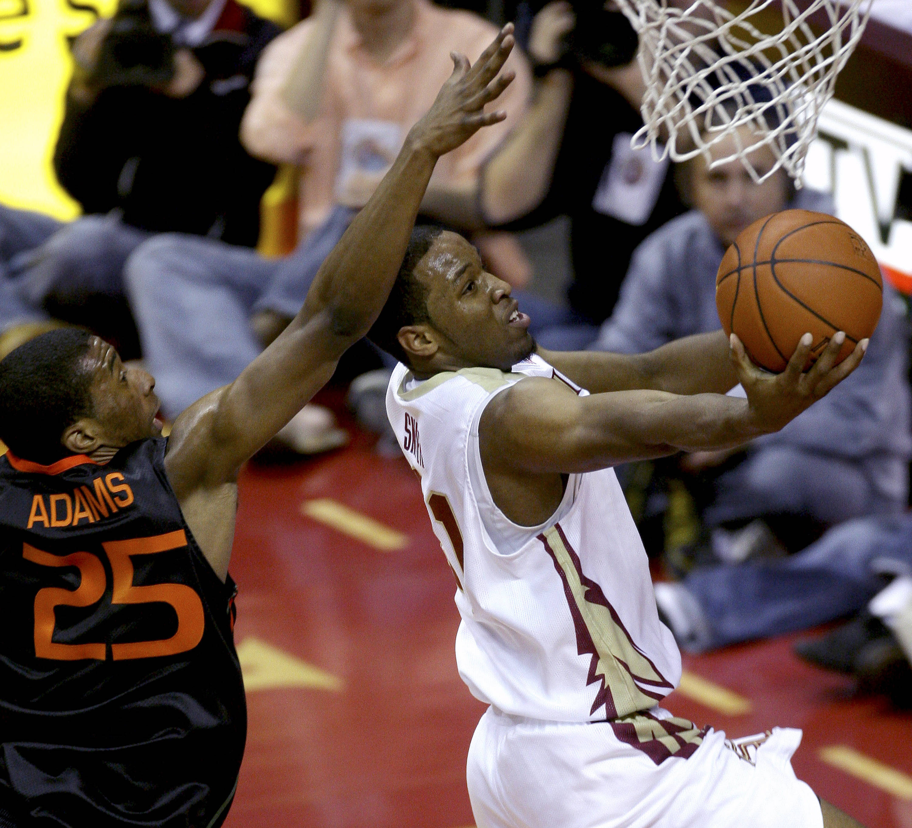Florida State's Michael Snaer, right, drives past Miami's Garrius Adams for two first-half points during an NCAA college basketball game, Saturday, Feb. 6, 2010, in Tallahassee, Fla. (AP Photo/Phil Coale)