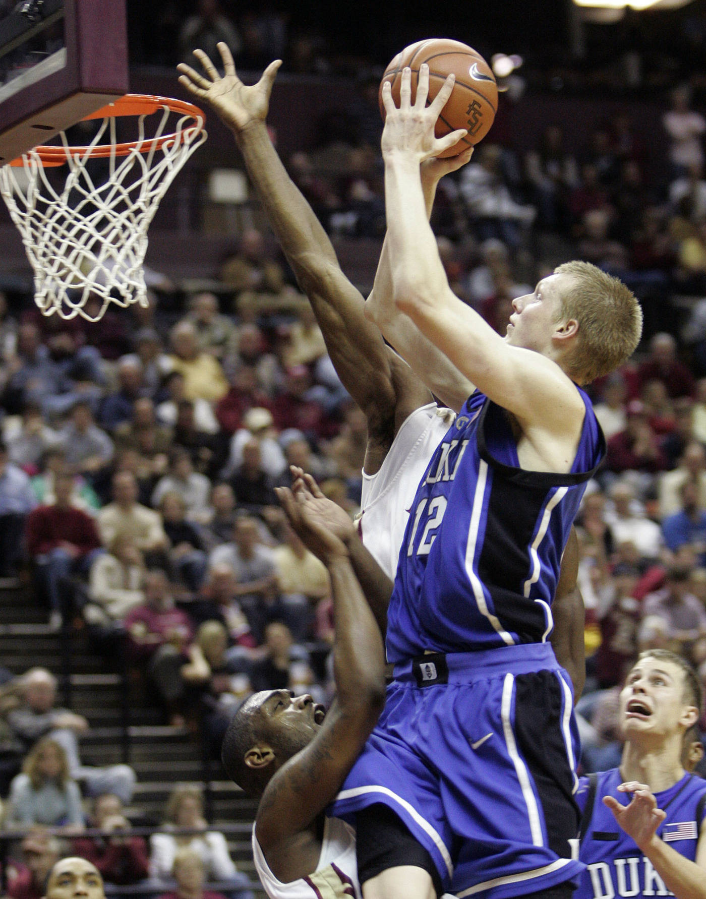 Duke's Kyle Singler shoots over the defense of Florida State's Uche Echefu and Ralph Mims, left in the second half of a college basketball game on Wednesday, Jan. 16, 2008 in Tallahassee, Fla. Duke won 70-57.