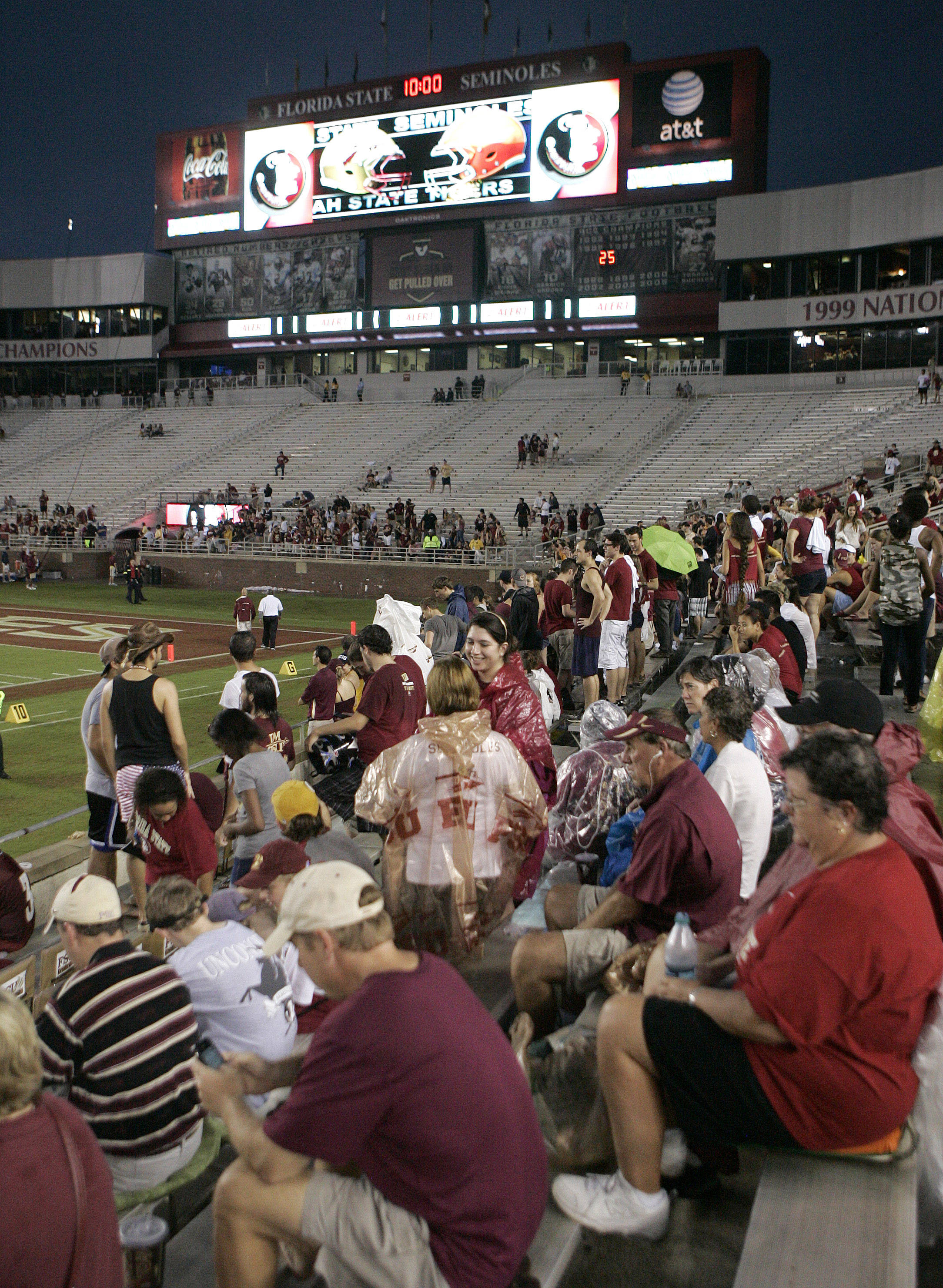 Fans wait in the stands for Florida State and Savannah State to resume their lightning-delayed game. (AP Photo/Steve Cannon)
