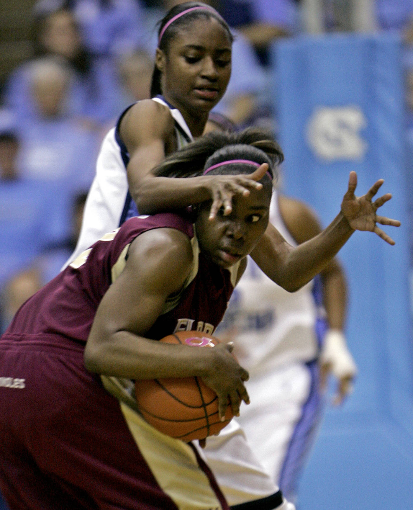 North Carolina's LaToya Pringle, rear, guards Florida State's Shante Williams during the first half of a college basketball game in Chapel Hill, N.C., Sunday, Feb. 17, 2008. (AP Photo/Gerry Broome)