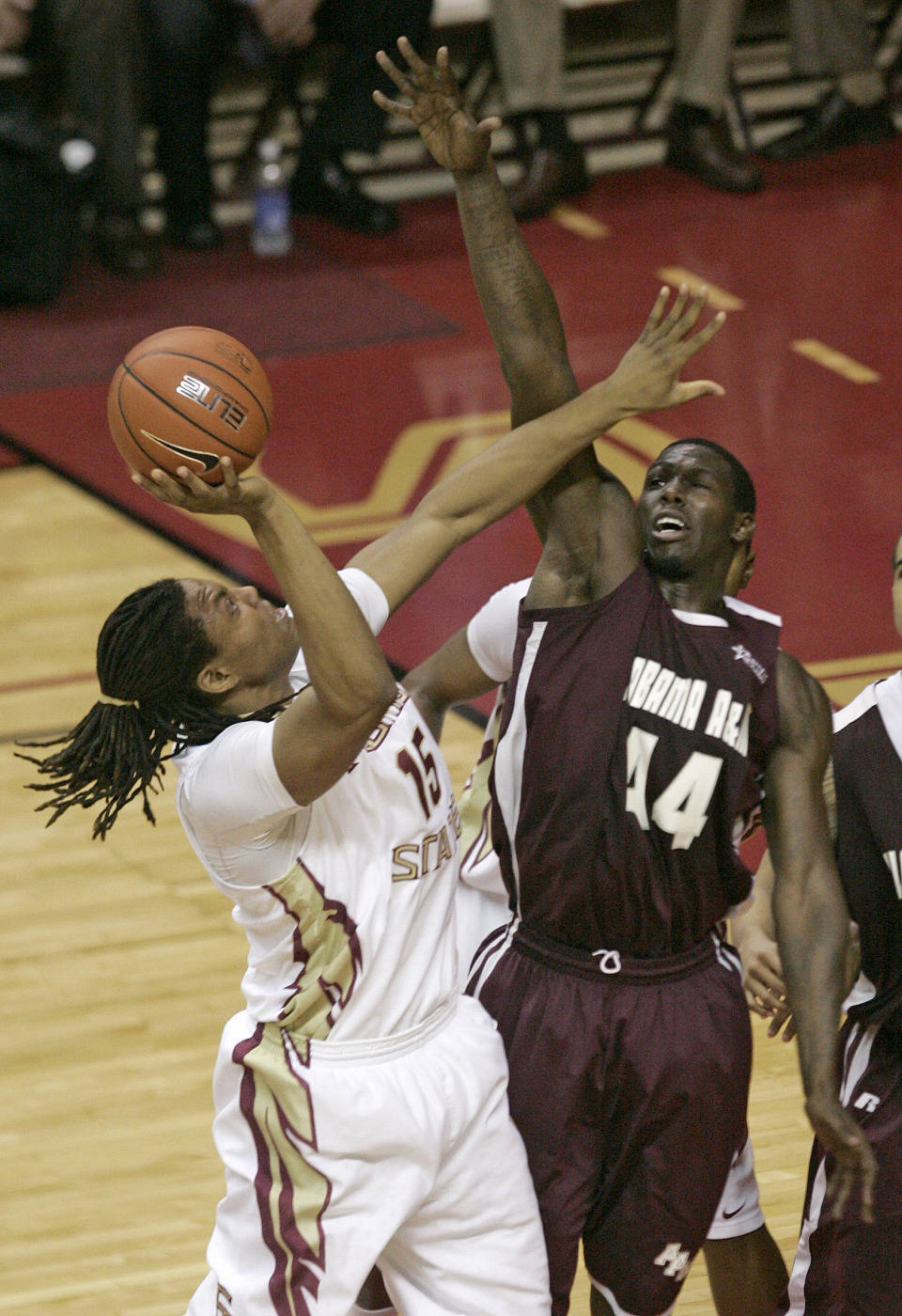 Florida State's Terrance Shannon,l eft, shoots over the defense of Alabama A&M's Jonathan Inman during the second half of an NCAA college basketball game on Thursday, Dec. 31, 2009, in Tallahassee, Fla. Florida State won 81-34. (AP Photo/Steve Cannon)