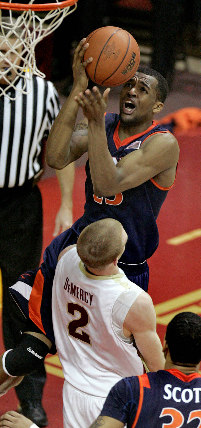 Virginia's Jeff Jones, top, is called for a foul as he charges into Florida State's Jordan DeMercy (2) in the second half. (AP Photo/Phil Coale)