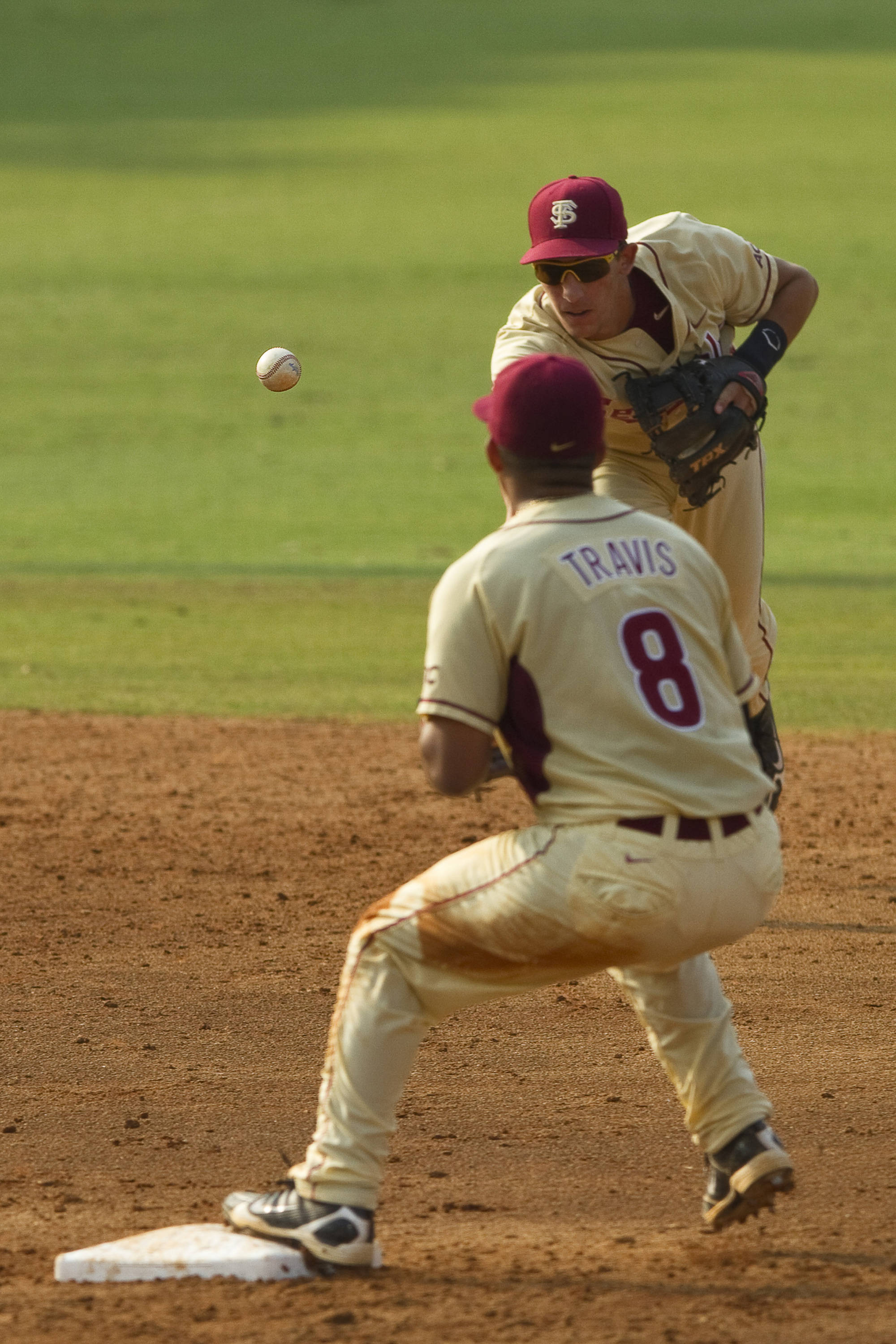 Justin Gonzalez (10) tosses the ball to Devon Travis (8) for a force out at second base.