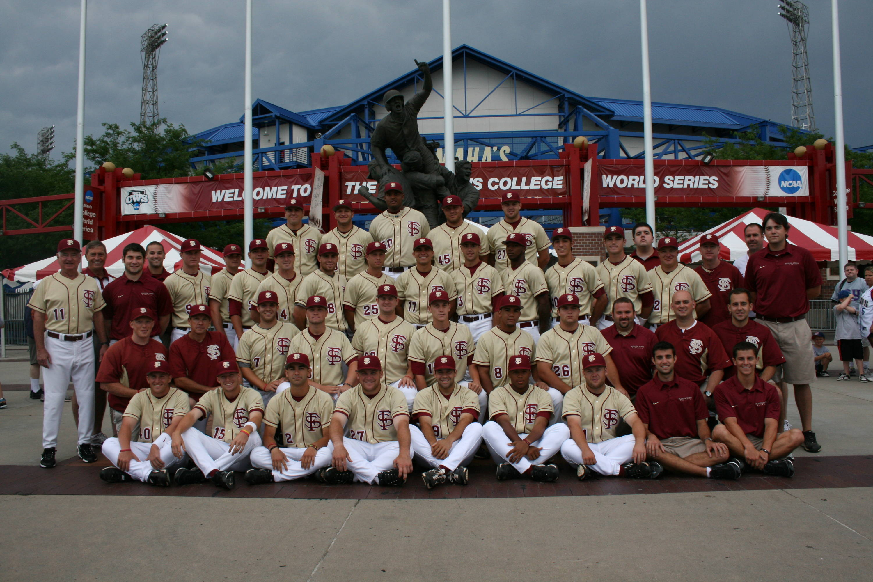 The 2010 Seminole pose in front of the famous statue outside Rosenblatt Stadium.