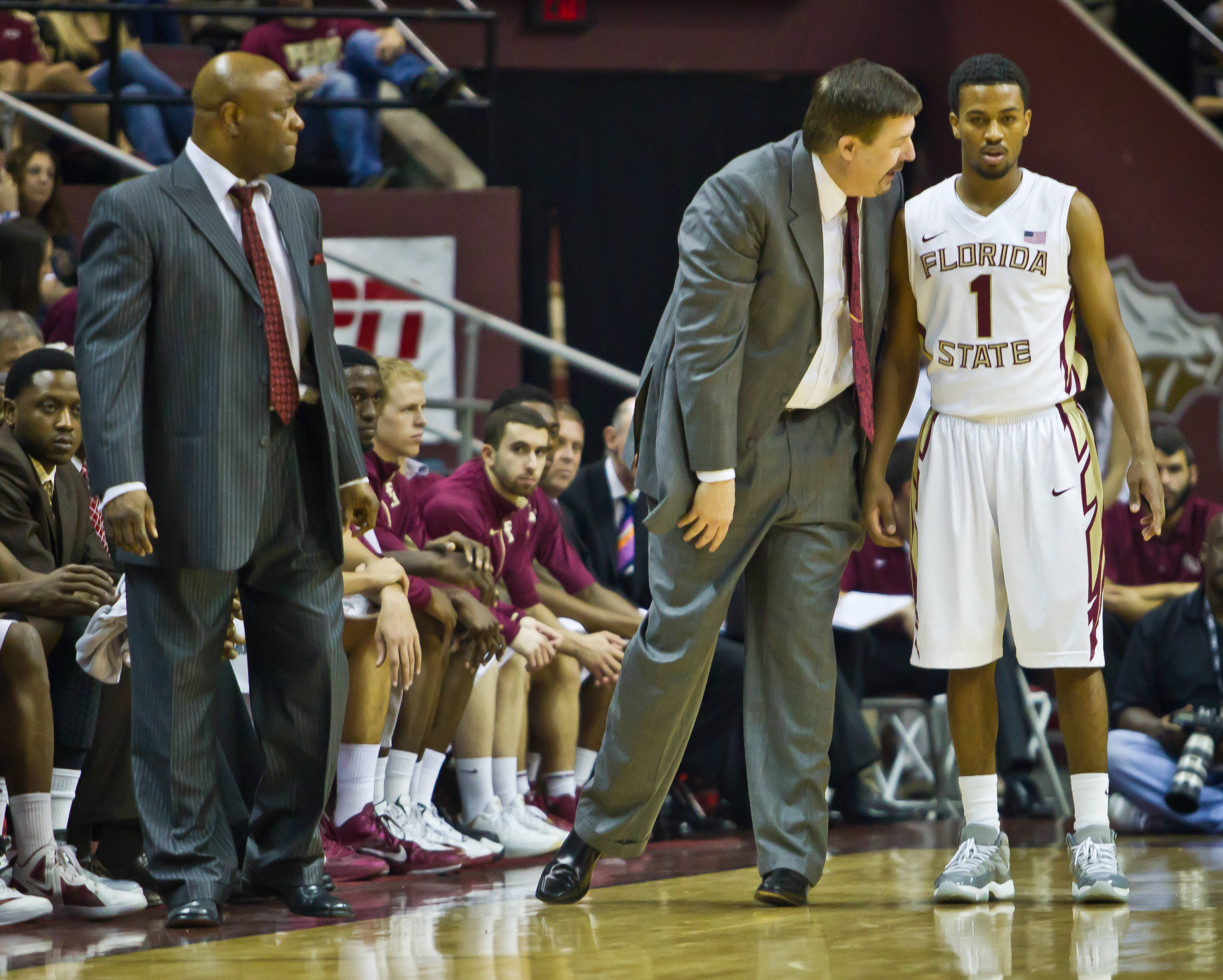 Devon Bookert (1) receives instructions from Stan Jones while Leonard Hamilton looks on.