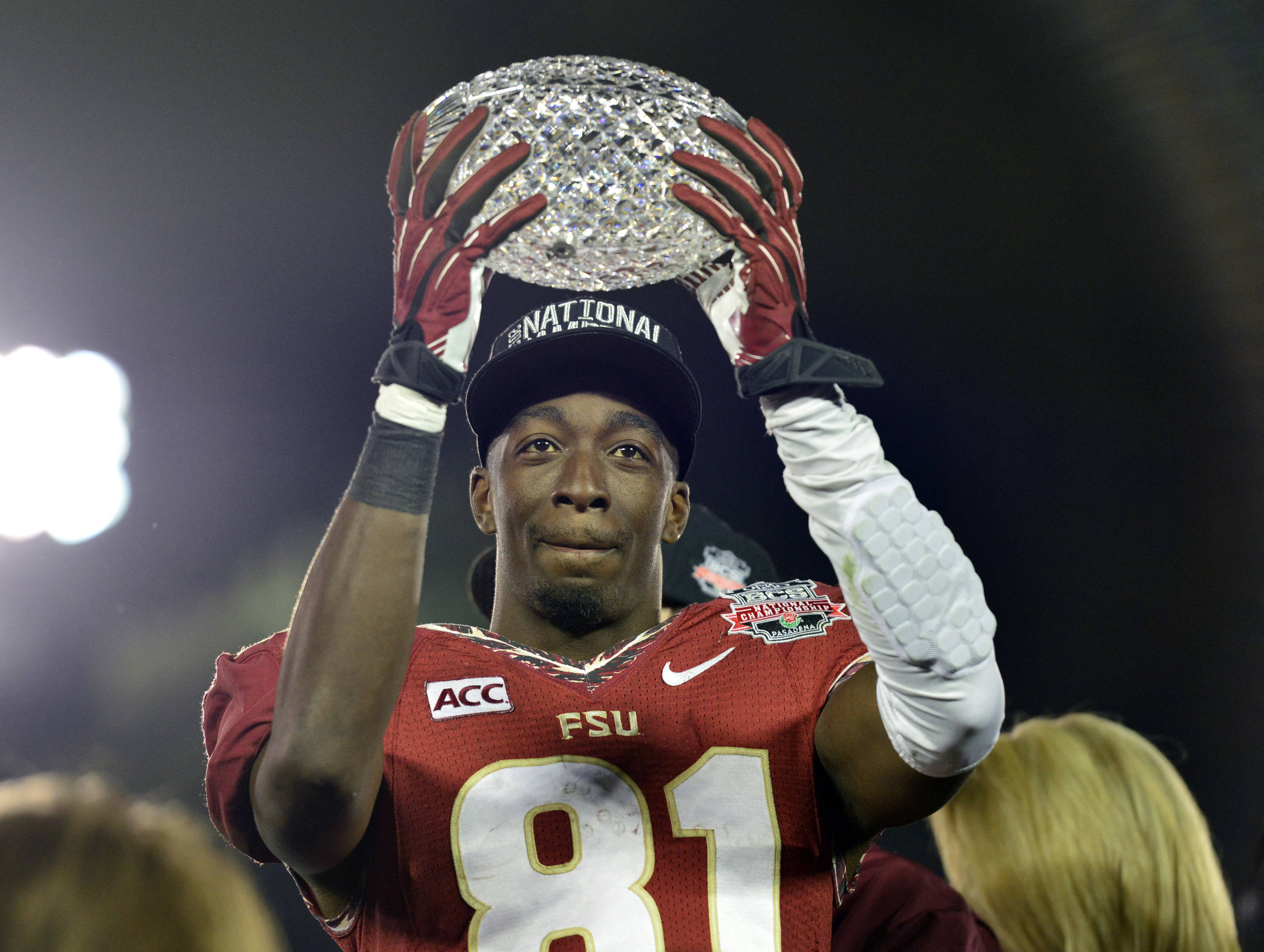 Jan 6, 2014; Pasadena, CA, USA; Florida State Seminoles wide receiver Kenny Shaw (81) celebrates with the Coaches Trophy after winning the 2014 BCS National Championship game against Auburn Tigers 34-31 at the Rose Bowl.  Mandatory Credit: Richard Mackson-USA TODAY Sports