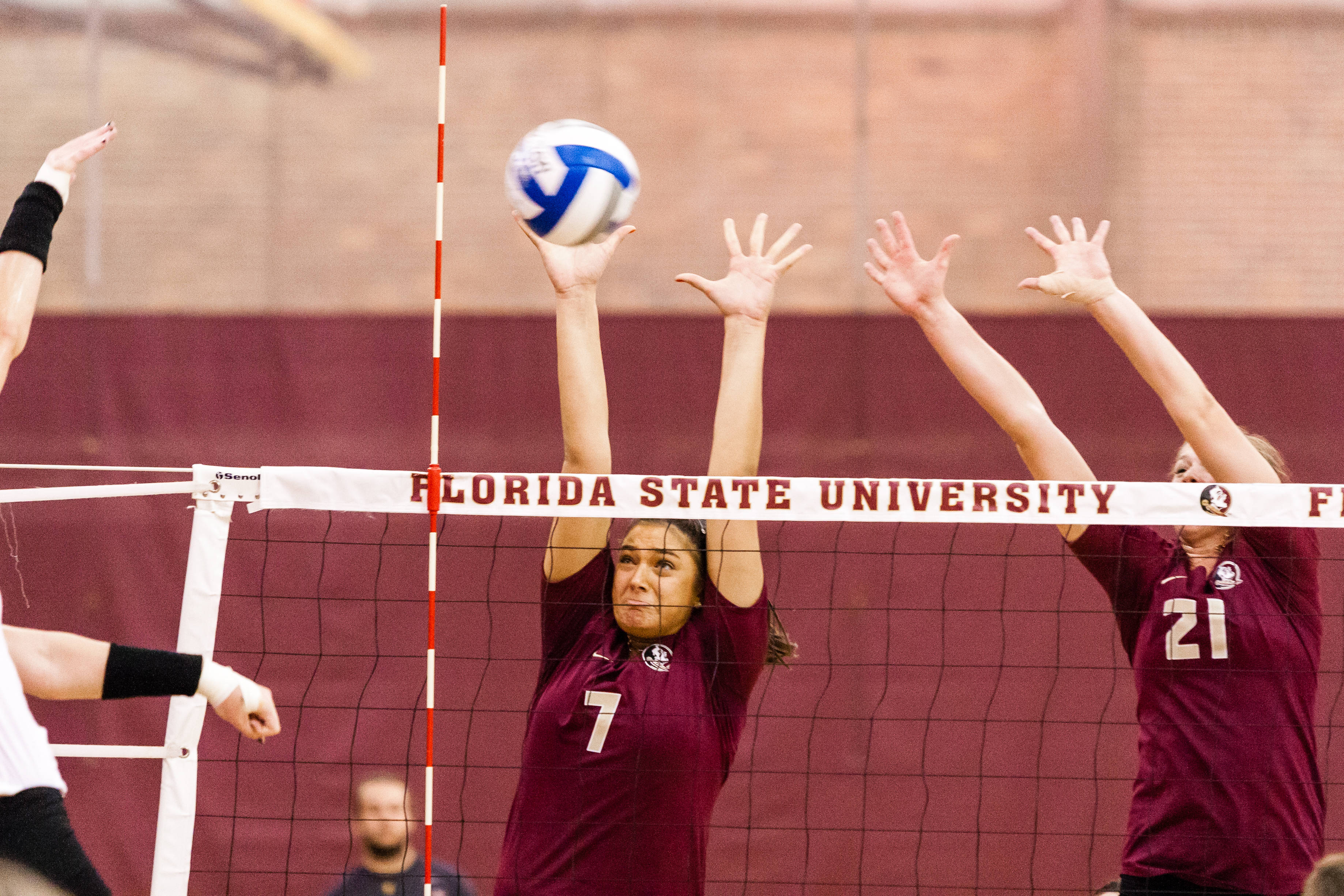 Milica Kubura goes in for a block with Melanie Keil.