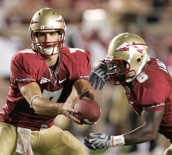 Florida State quarterback Christian Ponder, left, hands off to running back Antone Smith during the second quarter.