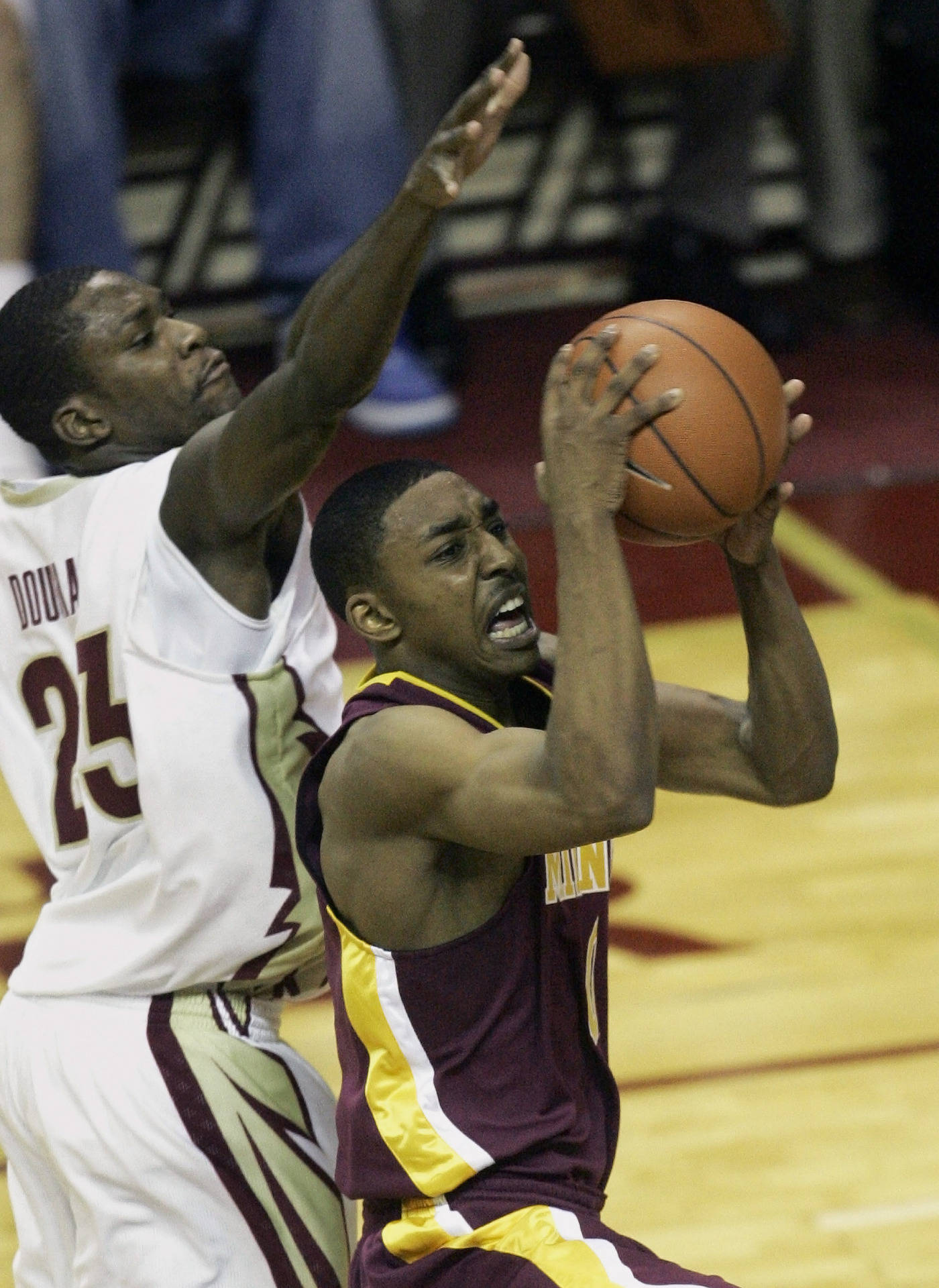 Minnesota's Al Nolen drives past Florida State's Tony Douglas for two first-half points.