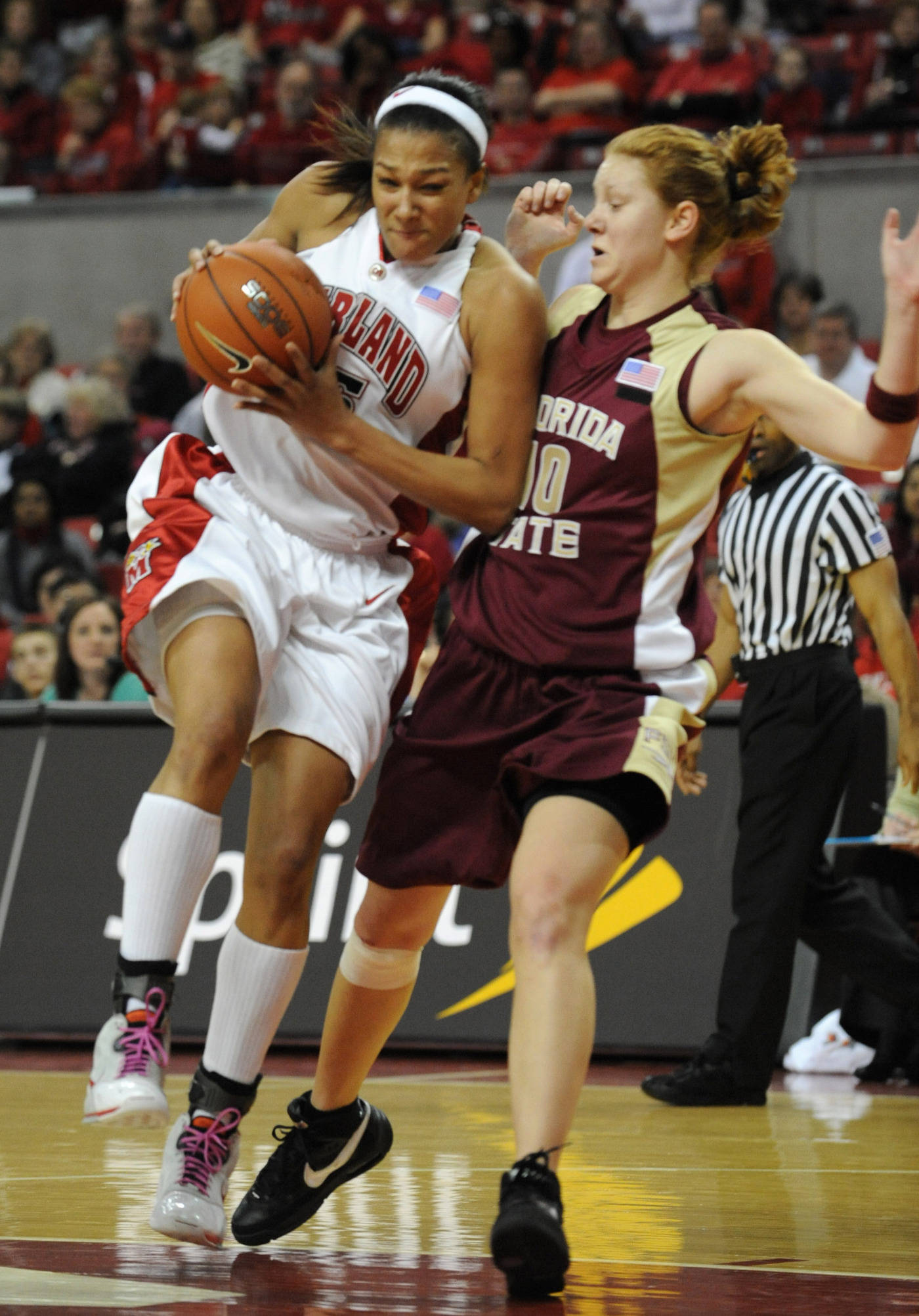 Maryland's Marissa Coleman, left, drives to the basket as Florida State's Mara Freshour defends during the first half of a college basketball game Sunday Feb. 24, 2008, in College Park, Md.(AP Photo/Gail Burton)