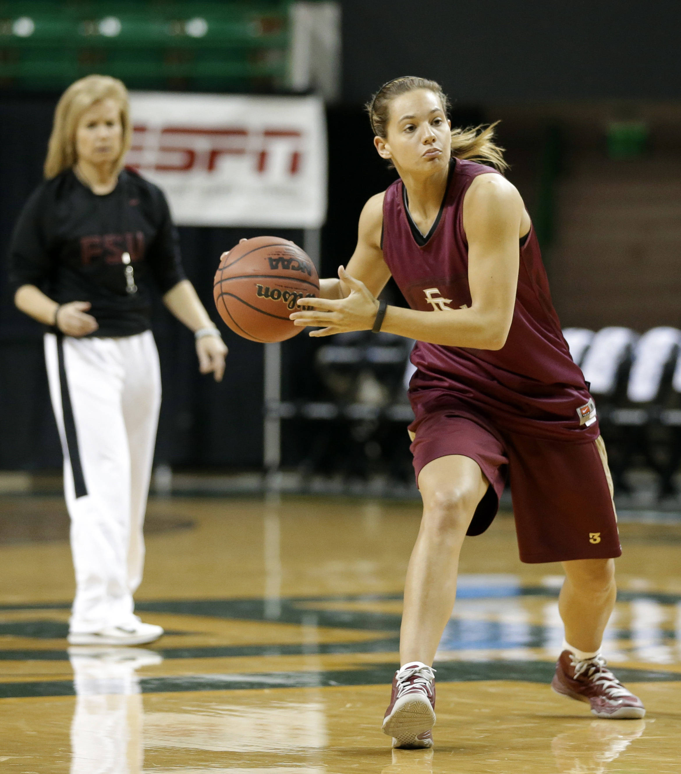 Florida State guard Alexa DeLuzio prepares to pass the ball as head coach Sue Semrau, left rear, watches during practice for a first-round game in the women's NCAA college basketball tournament Saturday, March 23, 2013, in Waco, Texas. FSU will play Princeton on Sunday. (AP Photo/Tony Gutierrez)